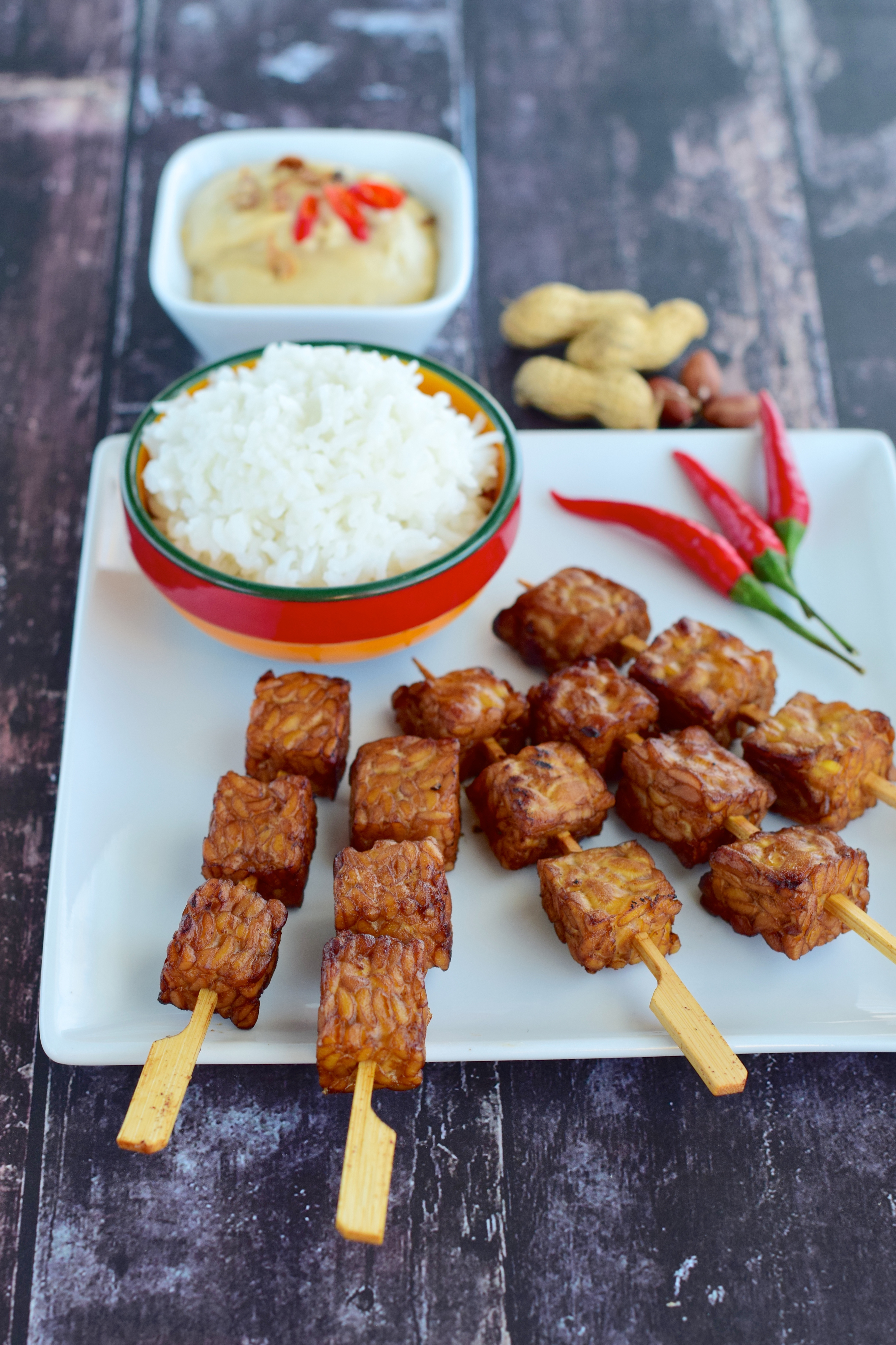 Cubed tempeh skewer with steamed rice and peanut sauce