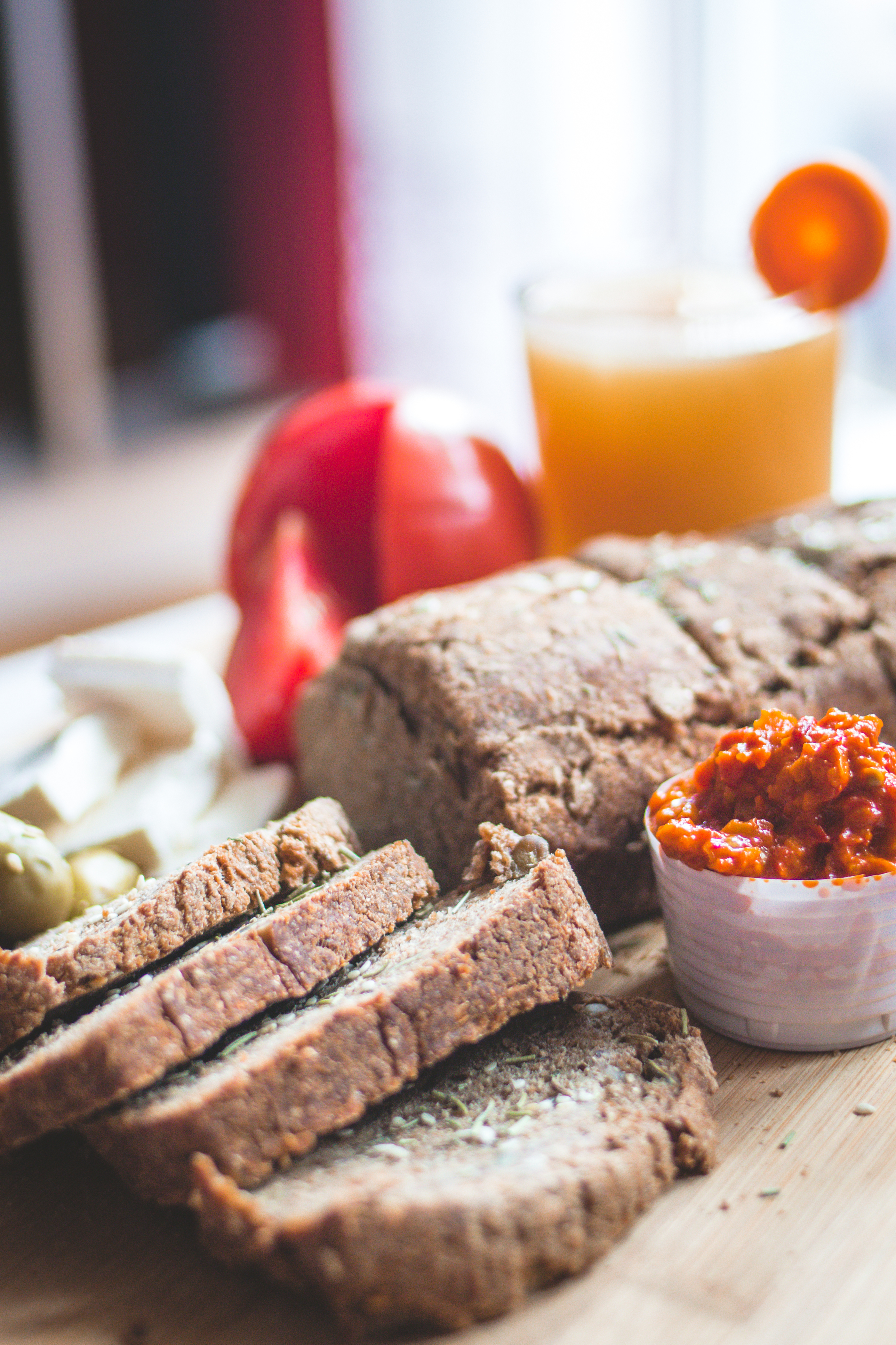 Chrono, organic, unleavened bread with various seeds, pumpkin, sunflower, flax seeds, carot juice, tomato, cheese, olives, ajvar on wooden board