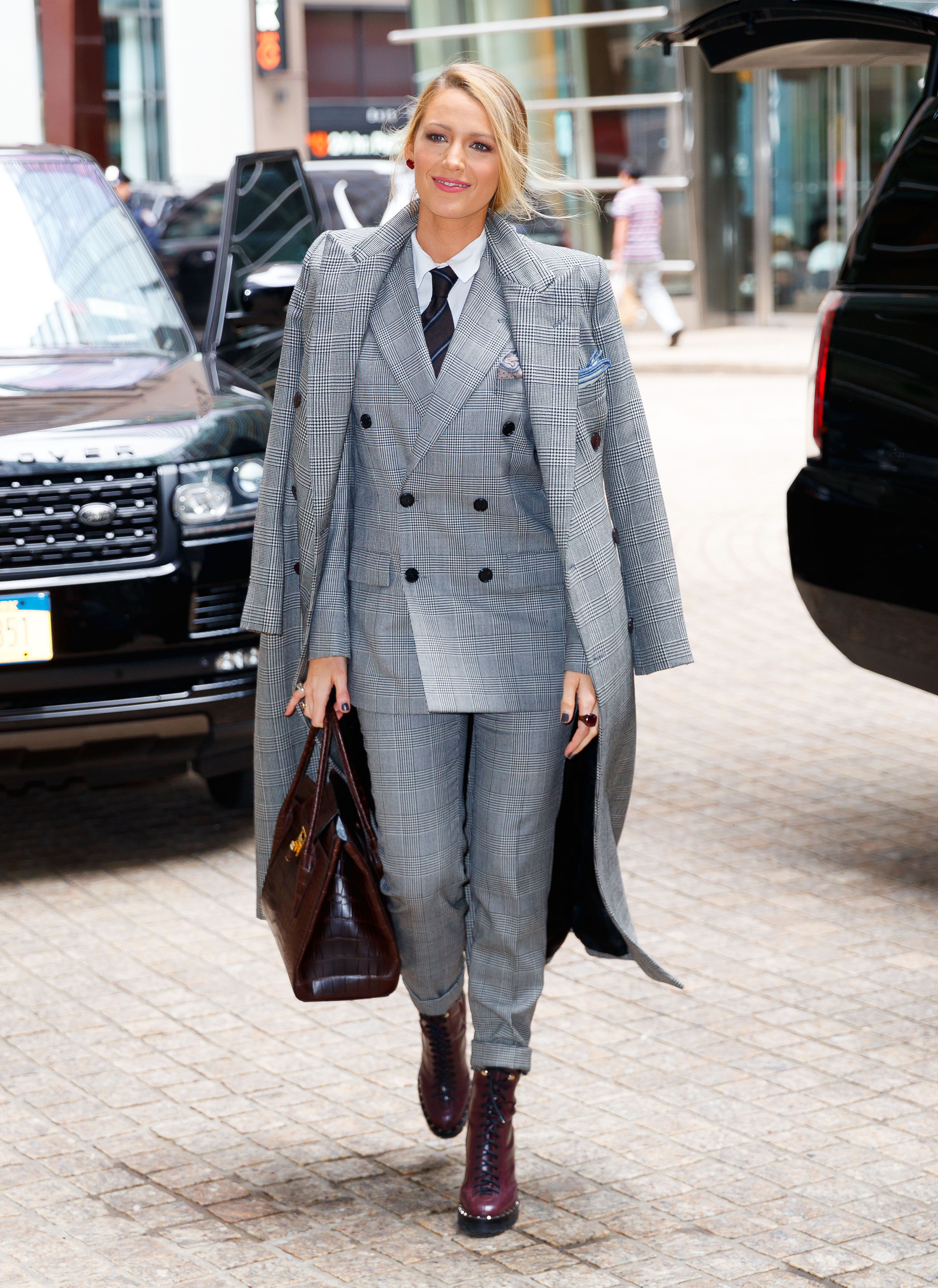 Blake Lively is all smiles in a double-breasted suit when coming out of her hotel in New York. <P> Pictured: Blake Lively <B>Ref: SPL1603268  161017  </B><BR/> Picture by: Jackson Lee / Splash News<BR/> </P><P> <B>Splash News and Pictures</B><BR/> Los Angeles:	310-821-2666<BR/> New York:	212-619-2666<BR/> London:	870-934-2666<BR/> <span id=