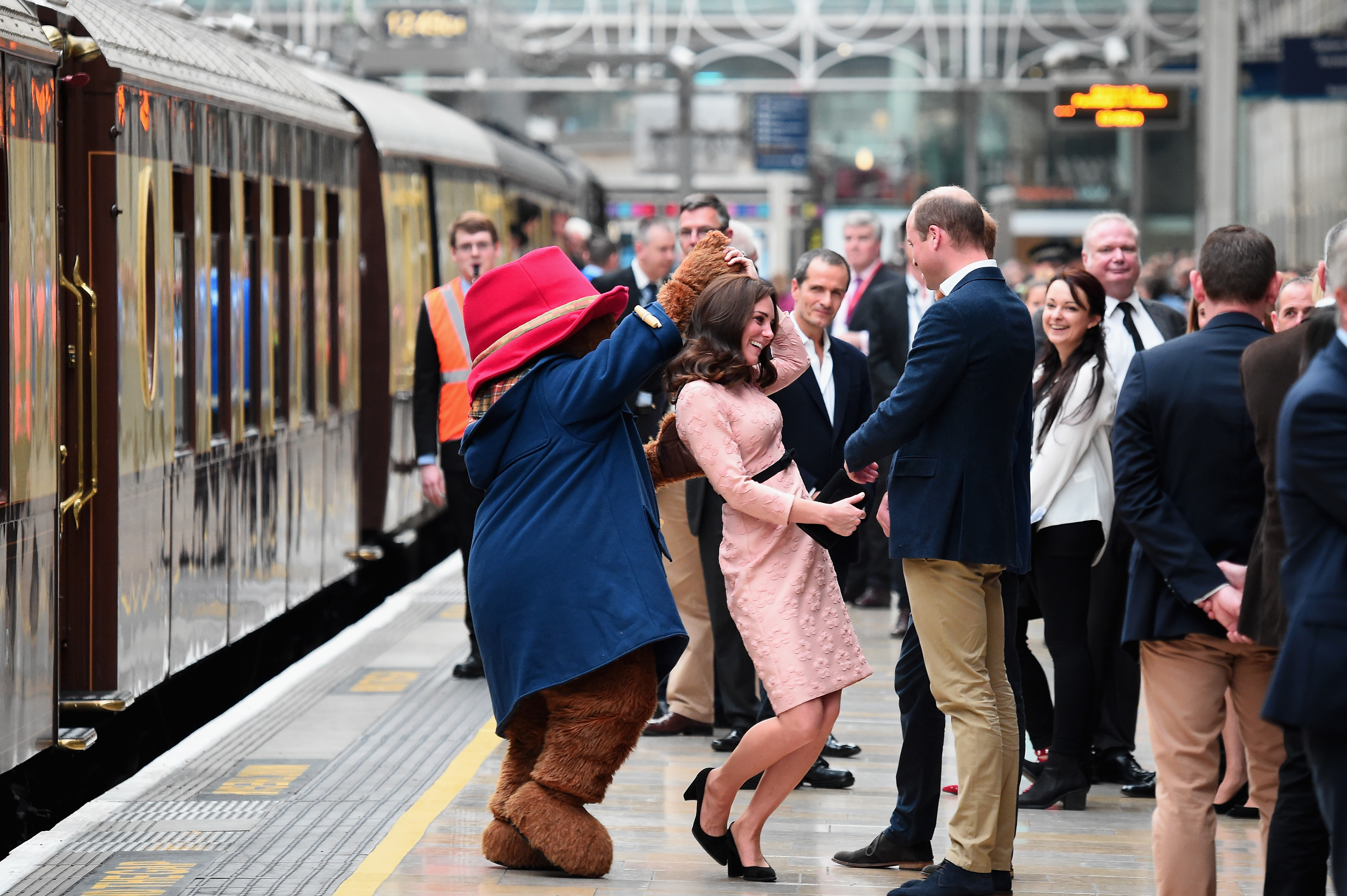 LONDON, ENGLAND - OCTOBER 16:  Paddington Bear dances with Catherine, Duchess of Cambridge and Prince William, Duke of Cambridge at the Charities Forum Event on board the Belmond Britigh Pullman train at Paddington Station on October 16, 2017 in London, England.  (Photo by Eamonn M. McCormack/Getty Images)