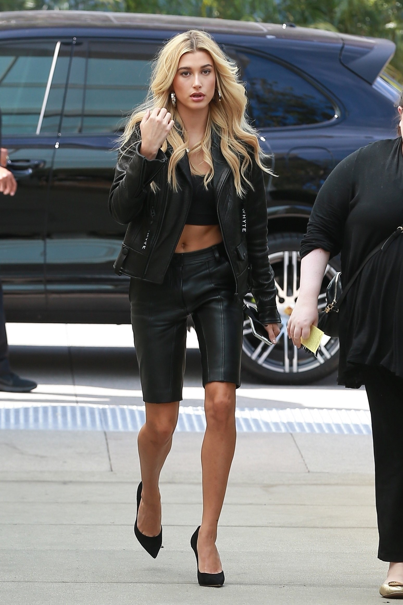 Hollywood, CA  - *EXCLUSIVE*  - Hailey Baldwin heads to a meeting in Hollywood. The blonde model is wearing leather bermuda shorts and a crop top paired with a leather moto jacket and heels. As temperatures reach the upper 80s today in Los Angeles, Hailey still manages to show some skin in her leather outfit.  Pictured: Hailey Baldwin  BACKGRID USA 17 OCTOBER 2017, Image: 353272902, License: Rights-managed, Restrictions: , Model Release: no, Credit line: Profimedia, AKM-GSI