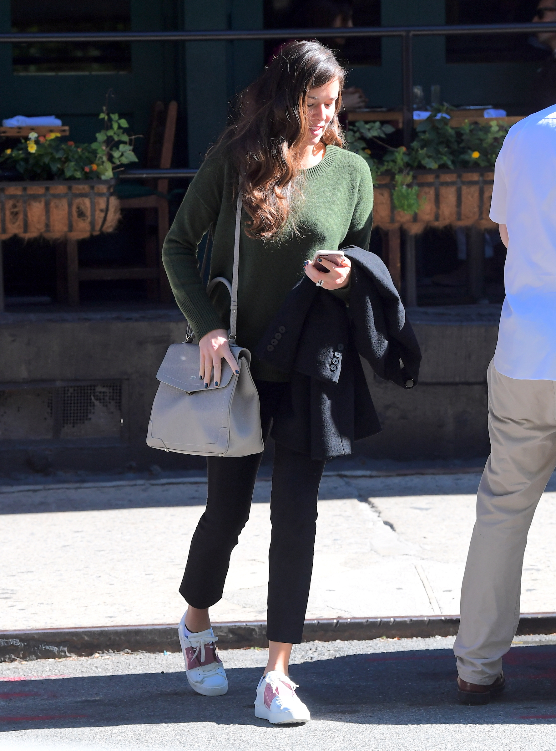 EXCLUSIVE: Ana Ivanovic, retired tennis star and wife of German Soccer superstar, Bastian Schweinsteiger, was spotted out in NYC on Thursday. She wore a baggy green sweater as she caught a flight out of town. She's been rumored to be pregnant, and she did nothing to dispel these rumors. She attempted to cover her stomach with a large purse, and a coat which she carried in front of her. But as she hopped in the car, a hint of a bump could be seen from the side.  <P> Pictured: Ana Ivanovic <B>Ref: SPL1605201  191017   EXCLUSIVE</B><BR/> Picture by: 247PAPS.TV / Splash News<BR/> </P><P> <B>Splash News and Pictures</B><BR/> Los Angeles:310-821-2666<BR/> New York:212-619-2666<BR/> London:870-934-2666<BR/> <span id=