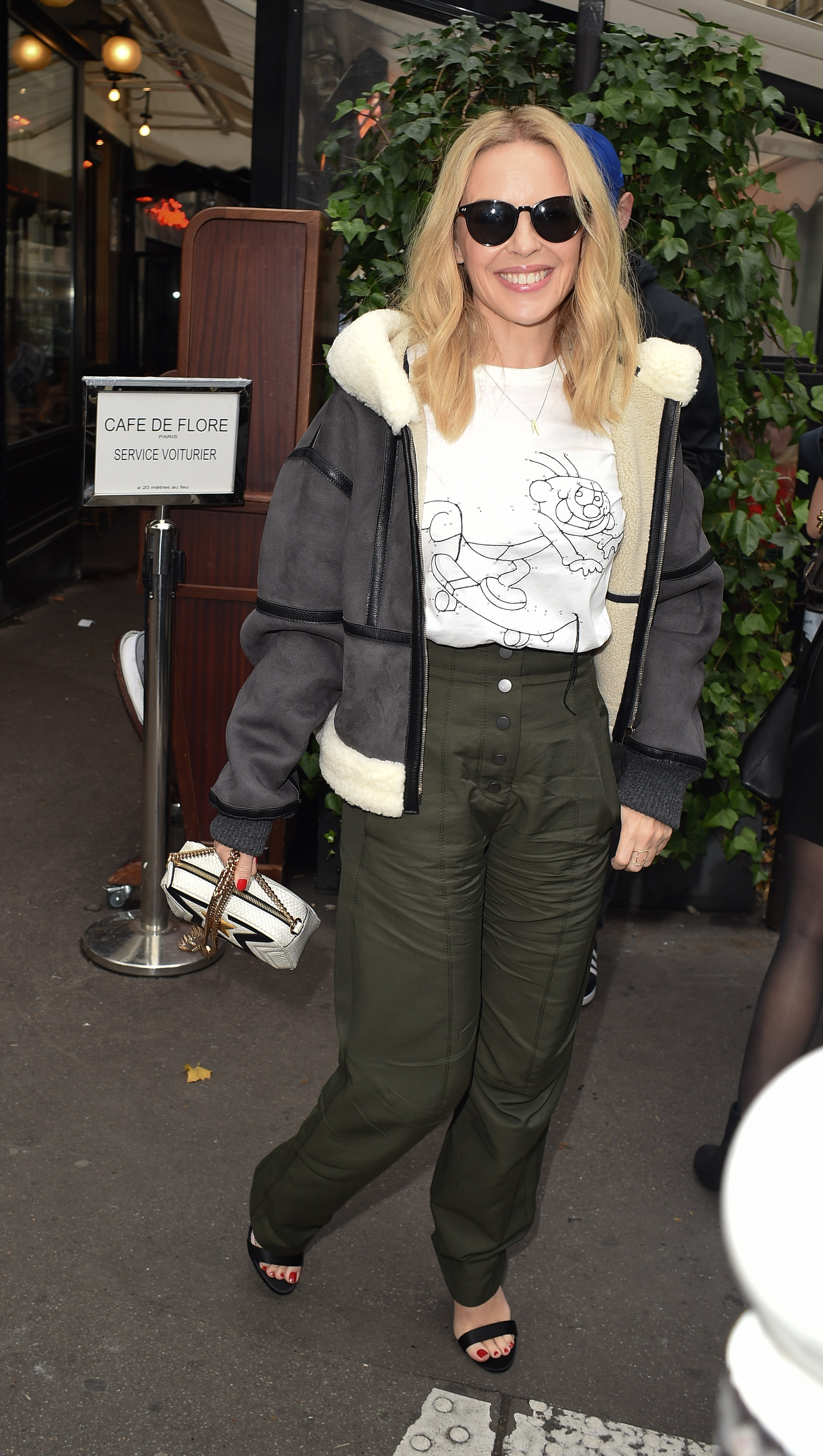 Kylie Minogue is seen at Cafe De flore in Paris <P> Pictured: Kylie Minogue <B>Ref: SPL1593564  021017  </B><BR/> Picture by: Neil Warner / Splash News<BR/> </P><P> <B>Splash News and Pictures</B><BR/> Los Angeles:310-821-2666<BR/> New York:212-619-2666<BR/> London:870-934-2666<BR/> <span id=