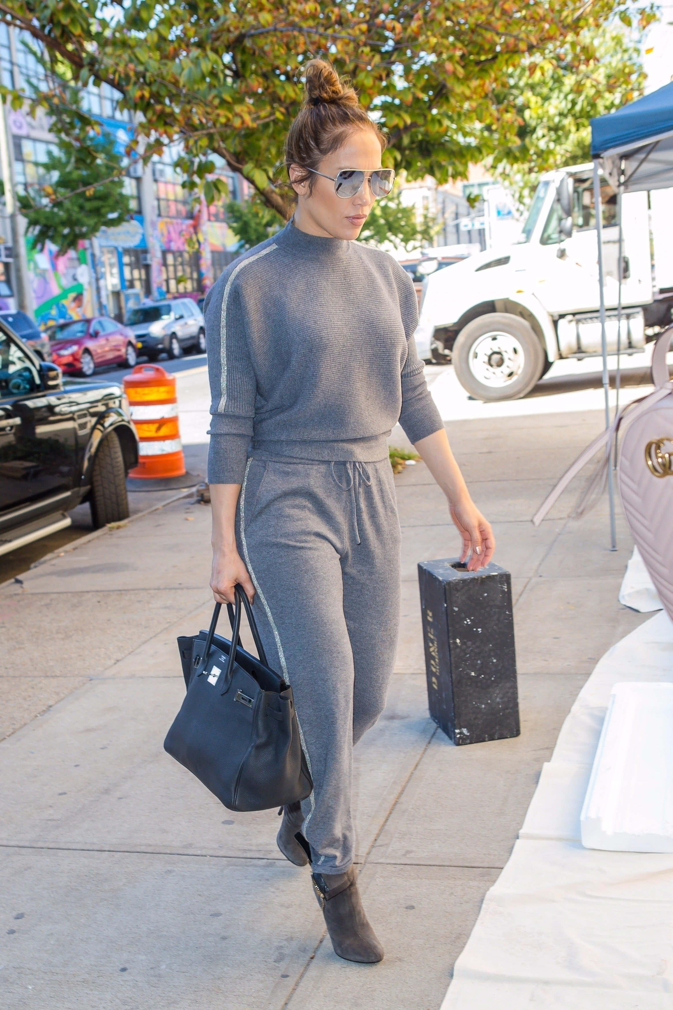 New York, NY  - *EXCLUSIVE*  - Jennifer Lopez shows off her curves as she arrives to the Studio in Brooklyn. Jennifer looks great in an all grey outfit and heels as she heads inside the building.  Pictured: Jennifer Lopez    *UK Clients - Pictures Containing Children Please Pixelate Face Prior To Publication*, Image: 353437722, License: Rights-managed, Restrictions: , Model Release: no, Credit line: Profimedia, AKM-GSI