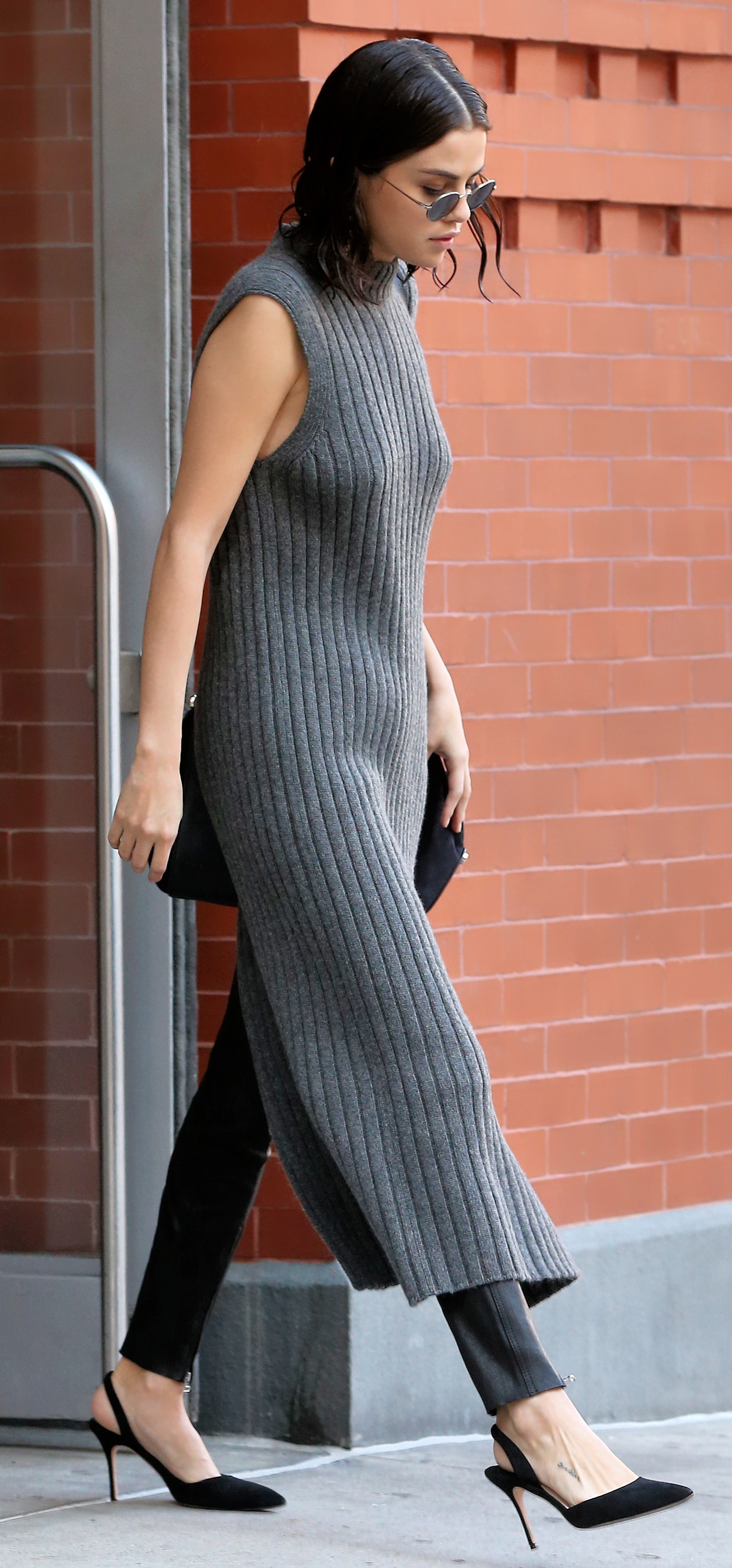 EXCLUSIVE: Singer Selena Gomez, wearing a full-length grey sweater dress, black leather pants and slingback pumps, is spotted leaving her apartment in New York City, New York, USA. <P> Pictured: Selena Gomez <B>Ref: SPL1606953  221017   EXCLUSIVE</B><BR/> Picture by: Christopher Peterson/Splash News<BR/> </P><P> <B>Splash News and Pictures</B><BR/> Los Angeles:310-821-2666<BR/> New York:212-619-2666<BR/> London:870-934-2666<BR/> <span id=