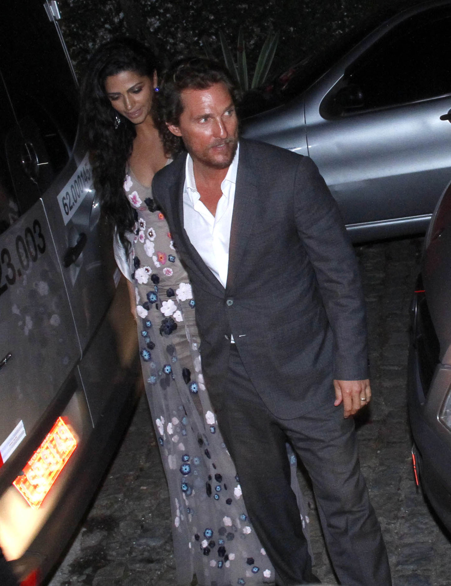 The Oscar-winning actor looked sharp in a grey suit and shirtless tie, with wife Camila shining in a long floral dress as they arrived at the after-party for super-manager Guy Oseary's vow renewals with Brazilian model wife Michelle Alves. A host of A-list celebrities have descended on Rio de Janeiro for the 0,000 bash, including Madonna, U2 and Red Hot Chili Peppers band members, Chris Rock, Dakota Johnson and others.  <P> Pictured: Matthew McConaughey and Camila Alves <B>Ref: SPL1608946  241017  </B><BR/> Picture by: Leo Marinho / Splash News<BR/> </P><P> <B>Splash News and Pictures</B><BR/> Los Angeles:310-821-2666<BR/> New York:212-619-2666<BR/> London:870-934-2666<BR/> <span id=