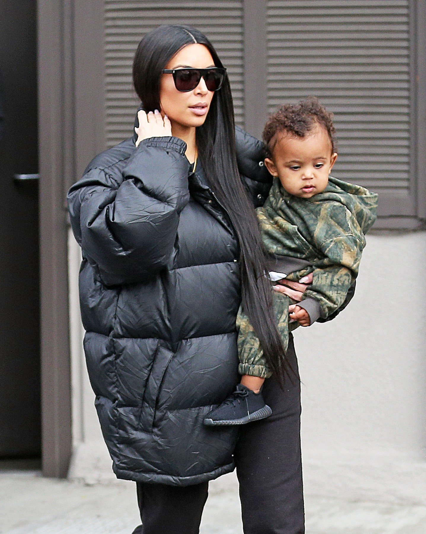 AG_171565 -  - Calabasas, CA - Kim Kardashian is spotted leaving Shirin with Kanye West. The mother of two walks with her daughter, North, and son, Saint. Kim is wearing sweatpants and a tee paired with an oversized puffer jacket and sneakers. Nori is wearing a green Calabasas ensemble and her hair worn in space buns. Saint looks adorable wearing all camo. Both of the kids are wearing Yeezy sneakers while Kim sports Vans. Kourtney Kardashian and her daughter Penelope leave dinner together. The mother daughter duo look cool both wearing black pants, Yeezy sneakers, and leather moto jackets.  Pictured: Kourtney Kardashian, Kim Kardashian, Kanye West  19 FEBRUARY 2017, Image: 321514821, License: Rights-managed, Restrictions: , Model Release: no, Credit line: Profimedia, AKM-GSI
