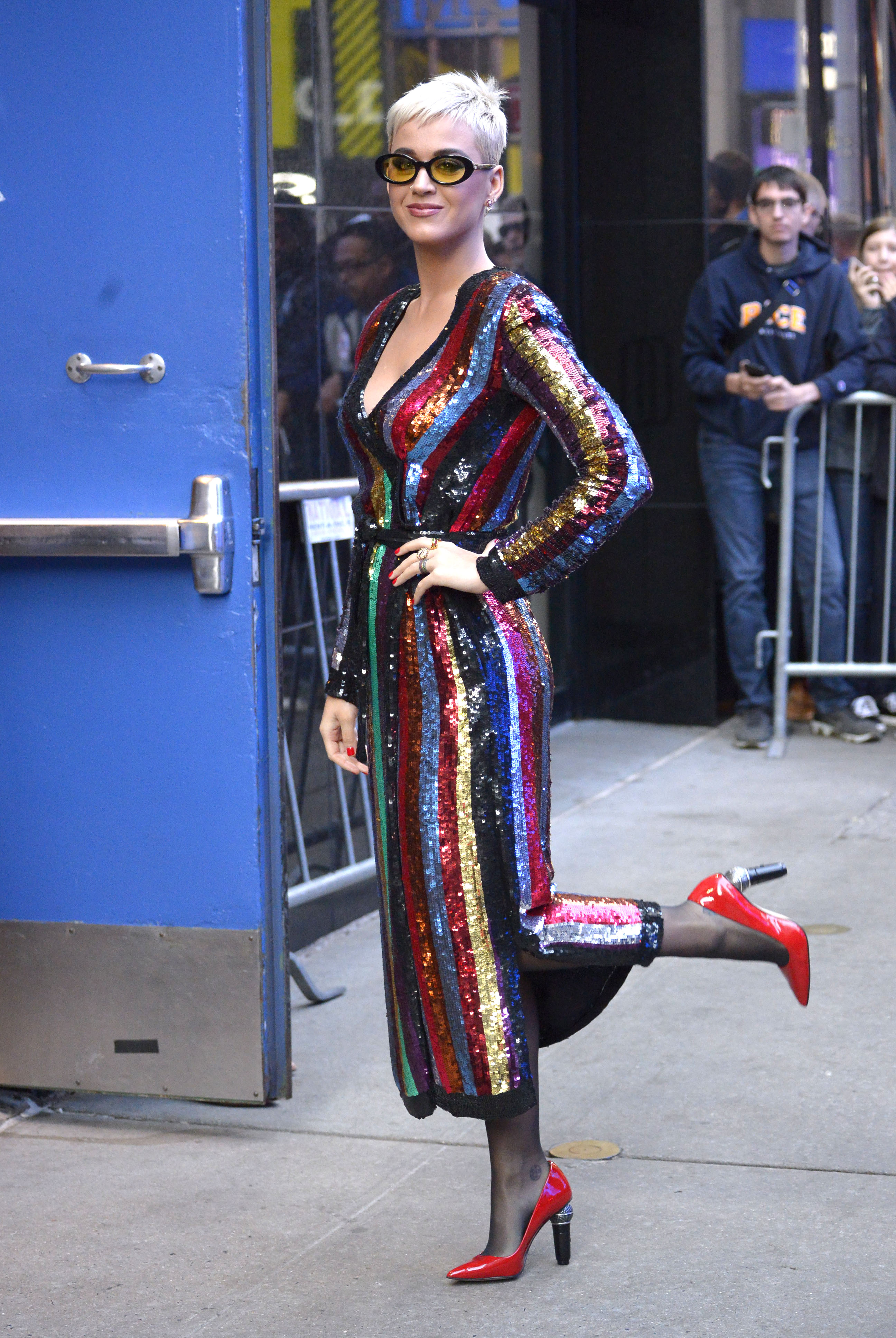 Katy Perry gives a wink and a leg kick while arriving in a colorful metallic dress at 'Good Morning America' to promote 'American Idol' in New York City. <P> Pictured: Katy Perry <B>Ref: SPL1594340  041017  </B><BR/> Picture by: Edward Opi / Splash News<BR/> </P><P> <B>Splash News and Pictures</B><BR/> Los Angeles:310-821-2666<BR/> New York:212-619-2666<BR/> London:870-934-2666<BR/> <span id=