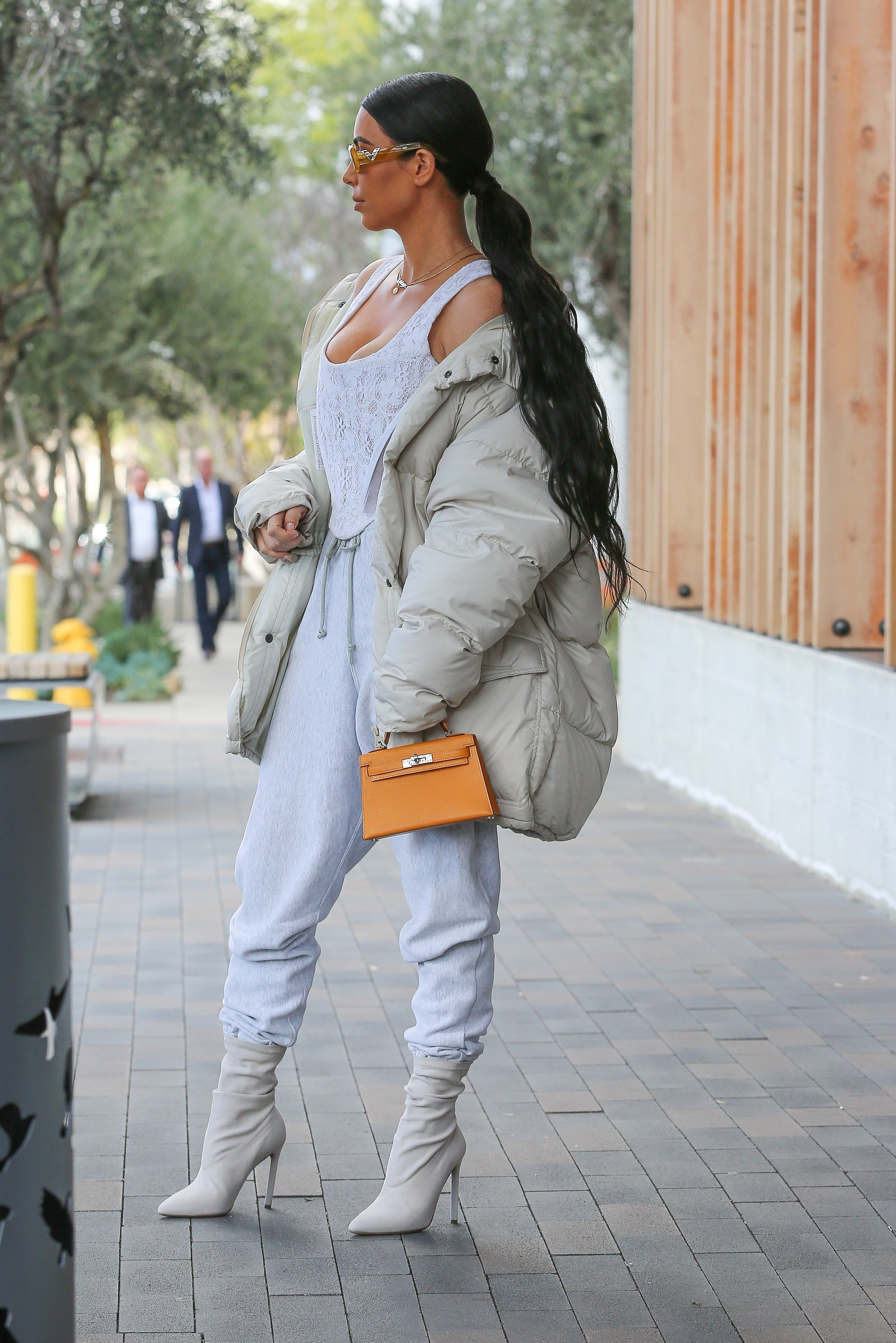 AG_172437 -  - Woodland Hills, CA - Kim Kardashian and Kourtney Kardashian show off their best street style looks while out for lunch with Penelope and Kris Jenner. Kim is wearing sweatpants and a corset style top paired with a white puffer jacket and matching boots. Kourtney is wearing olive green pants with a shearling leather jacket as she carries Penelope inside. Penelope looks cute wearing an Adidas panda outfit.  Pictured: Kris Jenner, Kourtney Kardashian, Kim Kardashian, Penelope Disick  22 FEBRUARY 2017, Image: 321915393, License: Rights-managed, Restrictions: , Model Release: no, Credit line: Profimedia, AKM-GSI