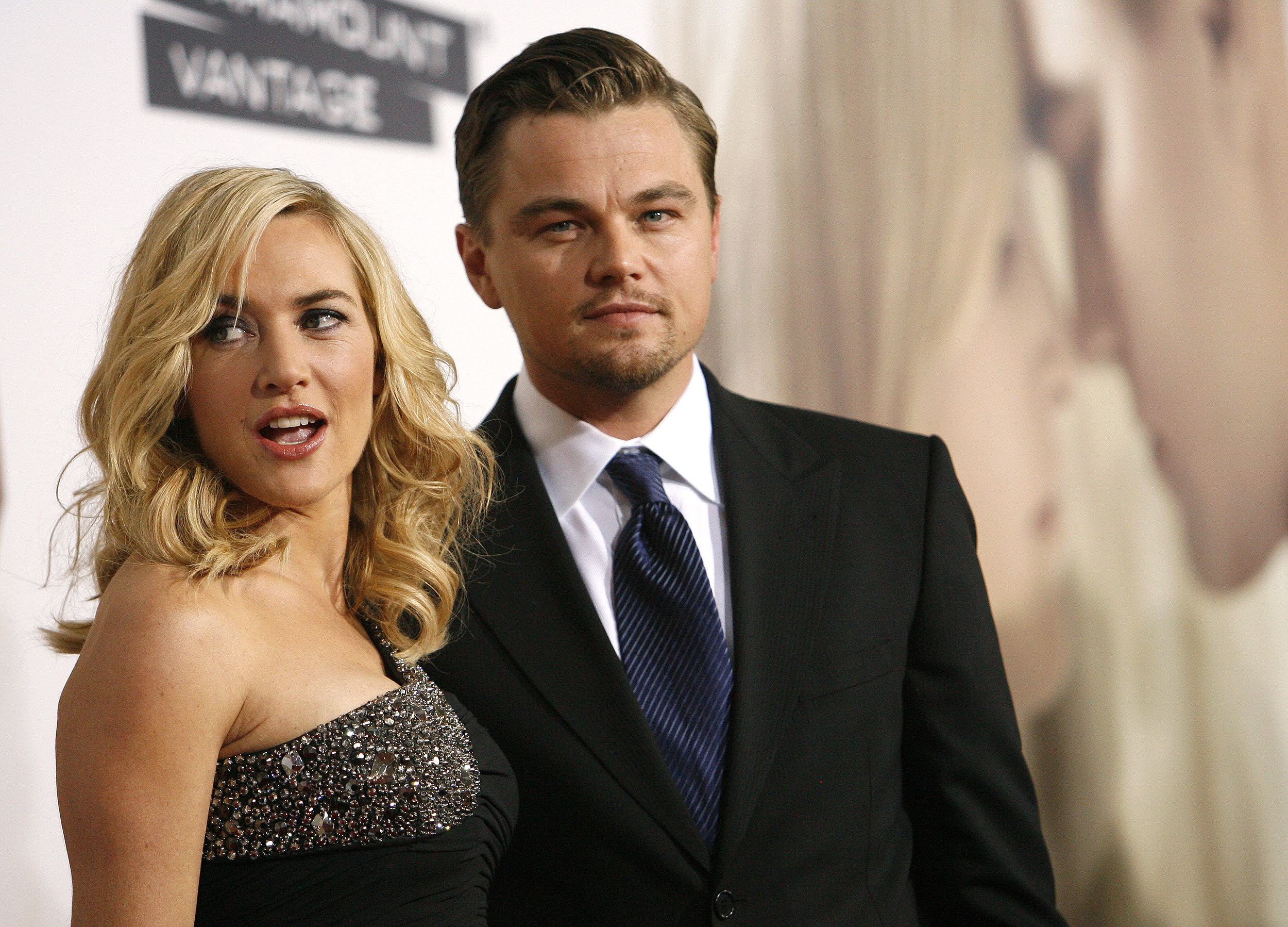Cast member Kate Winslet poses with co-star Leonardo DiCaprio at the premiere of the movie