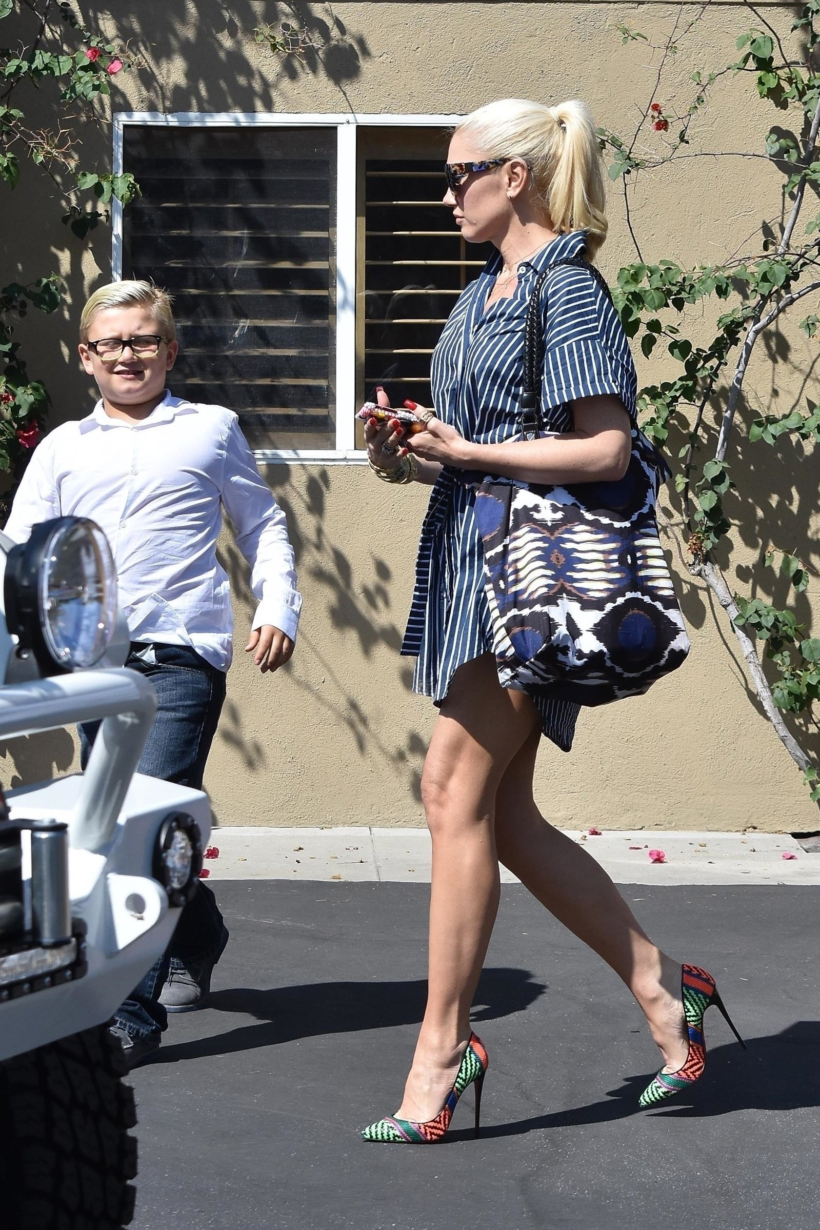 Los Angeles, CA  - *EXCLUSIVE*  - Gwen Stefani shows off her lacy pajama shorts while at church with her boys. Gwen shows off her long legs in the short t-shirt dress while chatting with her church friends after the Sunday service. Could the 47-year-old be expecting a fourth child with Blake Shelton? Radar reported she's pregnant with boyfriend Blake Shelton's baby.  Pictured: Gwen Stefani  BACKGRID USA 10 SEPTEMBER 2017, Image: 348970080, License: Rights-managed, Restrictions: , Model Release: no, Credit line: Profimedia, AKM-GSI