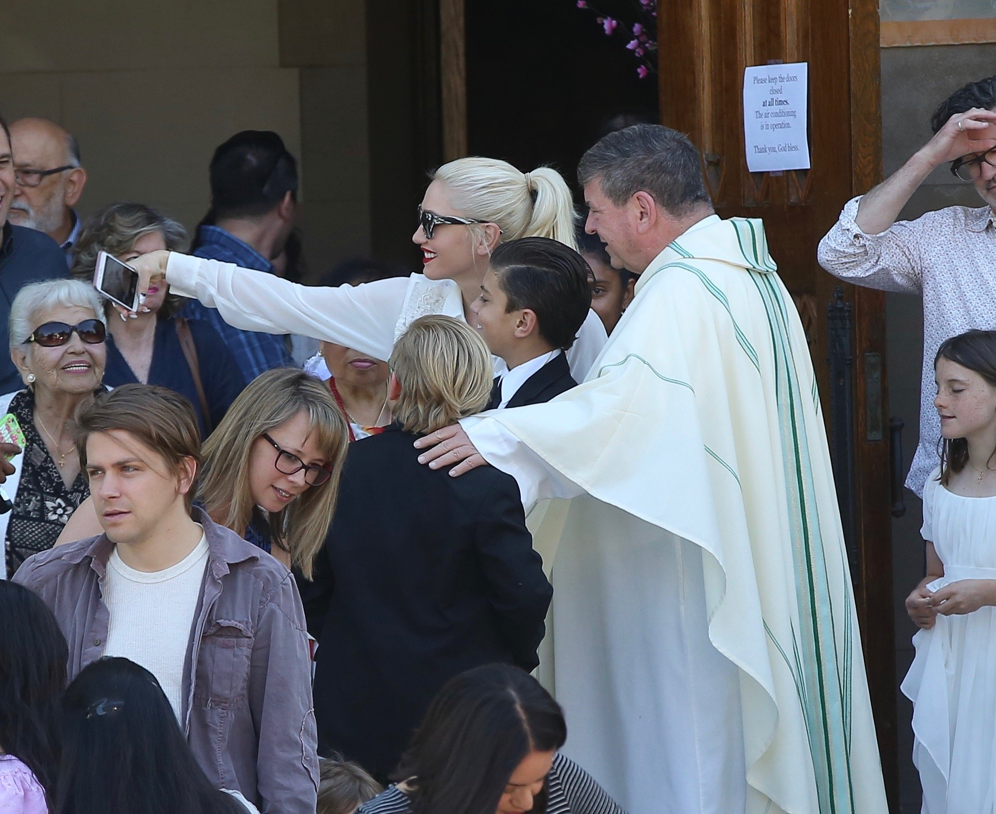 , Los Angeles, CA - 4/30/2017 -  Gwen Stefani attends church on Sunday. On Saturday, her son, kingston Rossdale, made his first communion. We can notice he received a necklace representing it. Gwen really likes the Priest! She took several photos with him.  After that, Gwen and Kingston went to Ralph's supermarket to buy some groceries.   -PICTURED: Gwen Stefani, Kingston Rossdale -, Image: 330727775, License: Rights-managed, Restrictions: , Model Release: no, Credit line: Profimedia, INSTAR Images