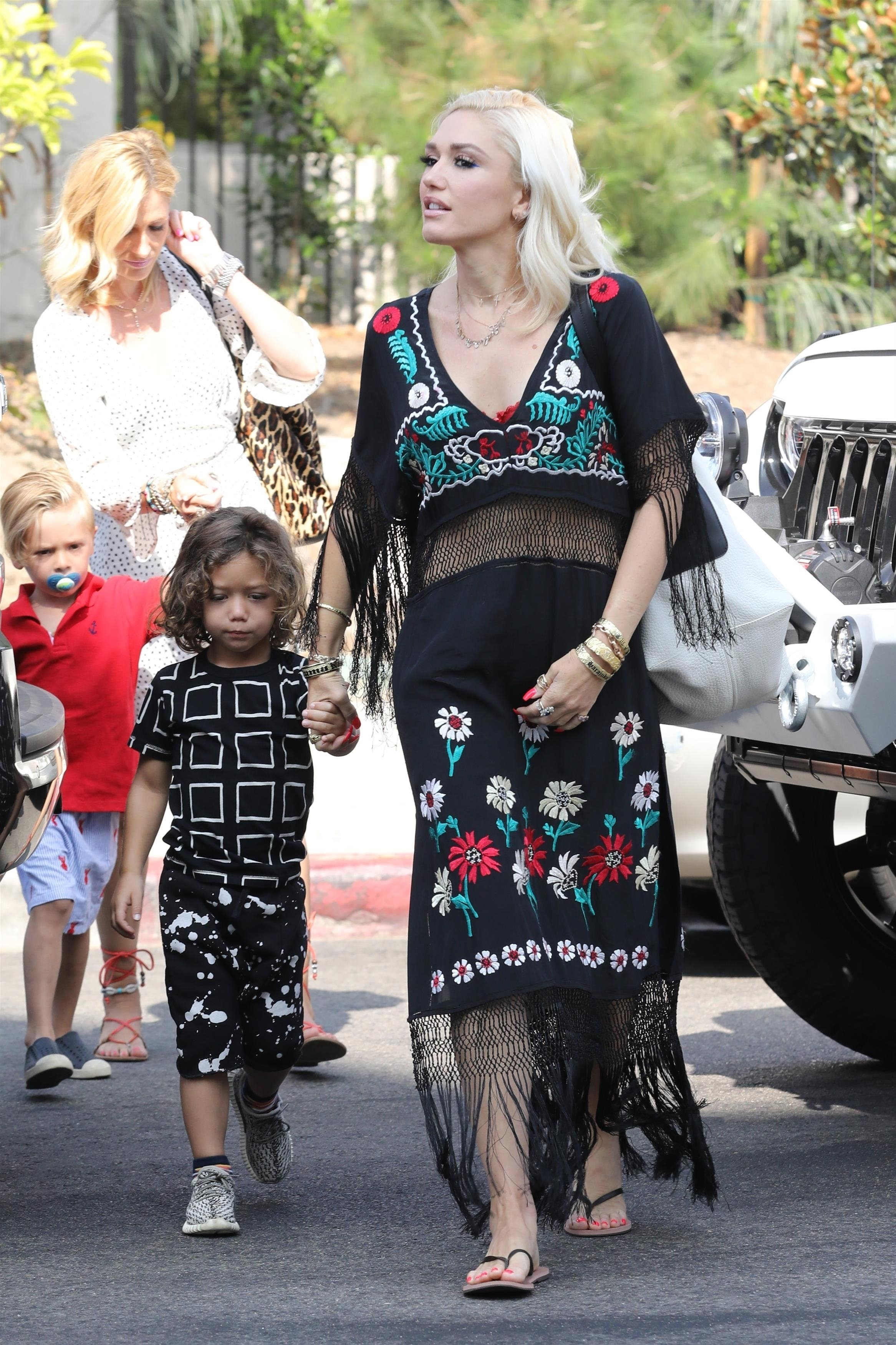 Los Angeles, CA  - Stylish mom and singer Gwen Stefani looks glam as she arrives to church with her boys, Kingston, Zuma, and Apollo. The platinum star is wearing an embroidered fringe frock paired with flip flops for Sunday service.  Pictured: Gwen Stefani  BACKGRID USA 13 AUGUST 2017, Image: 344954227, License: Rights-managed, Restrictions: , Model Release: no, Credit line: Profimedia, AKM-GSI