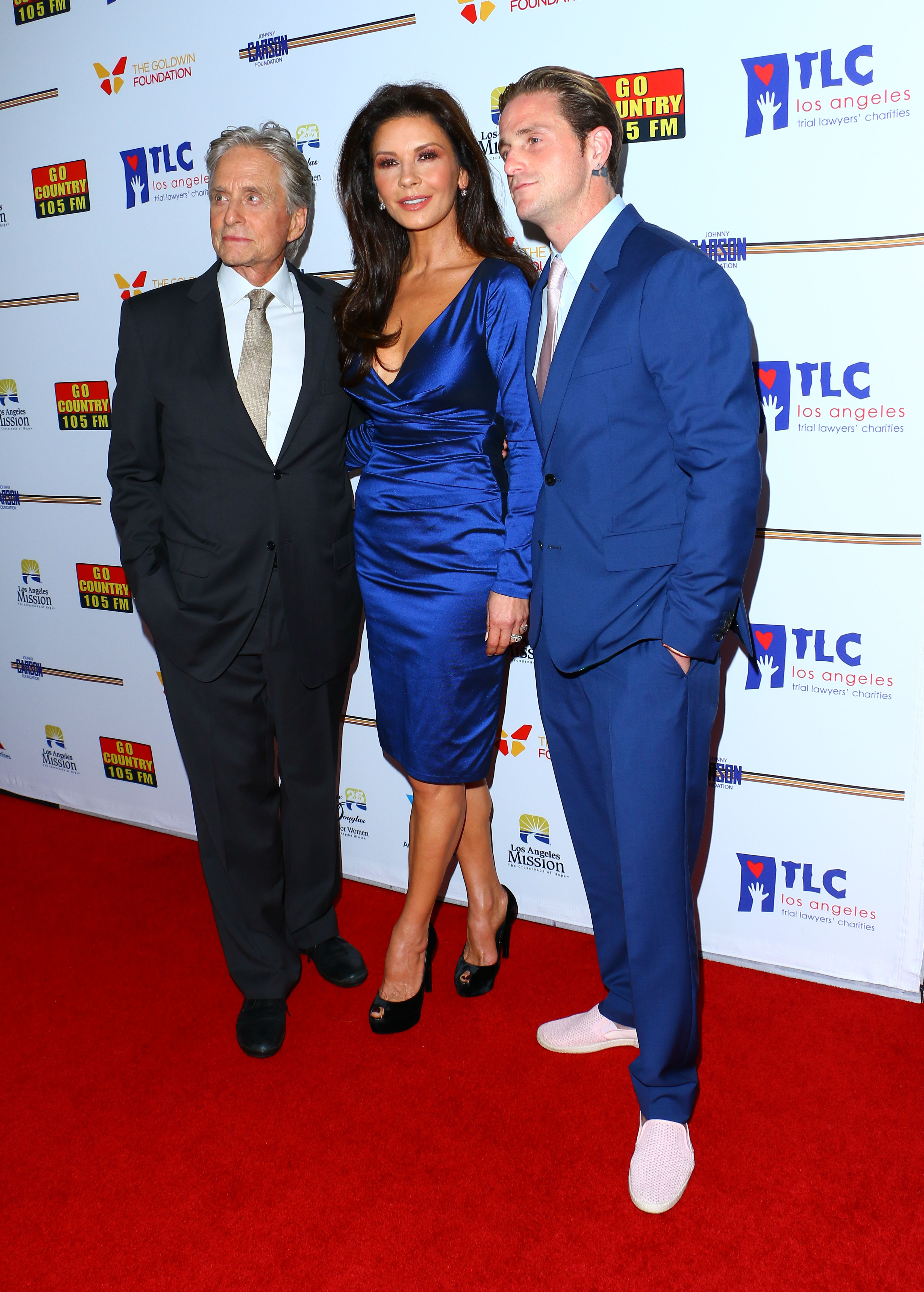 Catherine Zeta-Jones honored at the 7th Annual Legacy of Vision Gala in Los Angeles, CA. <P> Pictured: Michael Douglas, Catherine Zeta-Jones and Cameron Douglas <B>Ref: SPL1617100  091117  </B><BR/> Picture by: ITM / Splash News<BR/> </P><P> <B>Splash News and Pictures</B><BR/> Los Angeles:310-821-2666<BR/> New York:212-619-2666<BR/> London:870-934-2666<BR/> <span id=