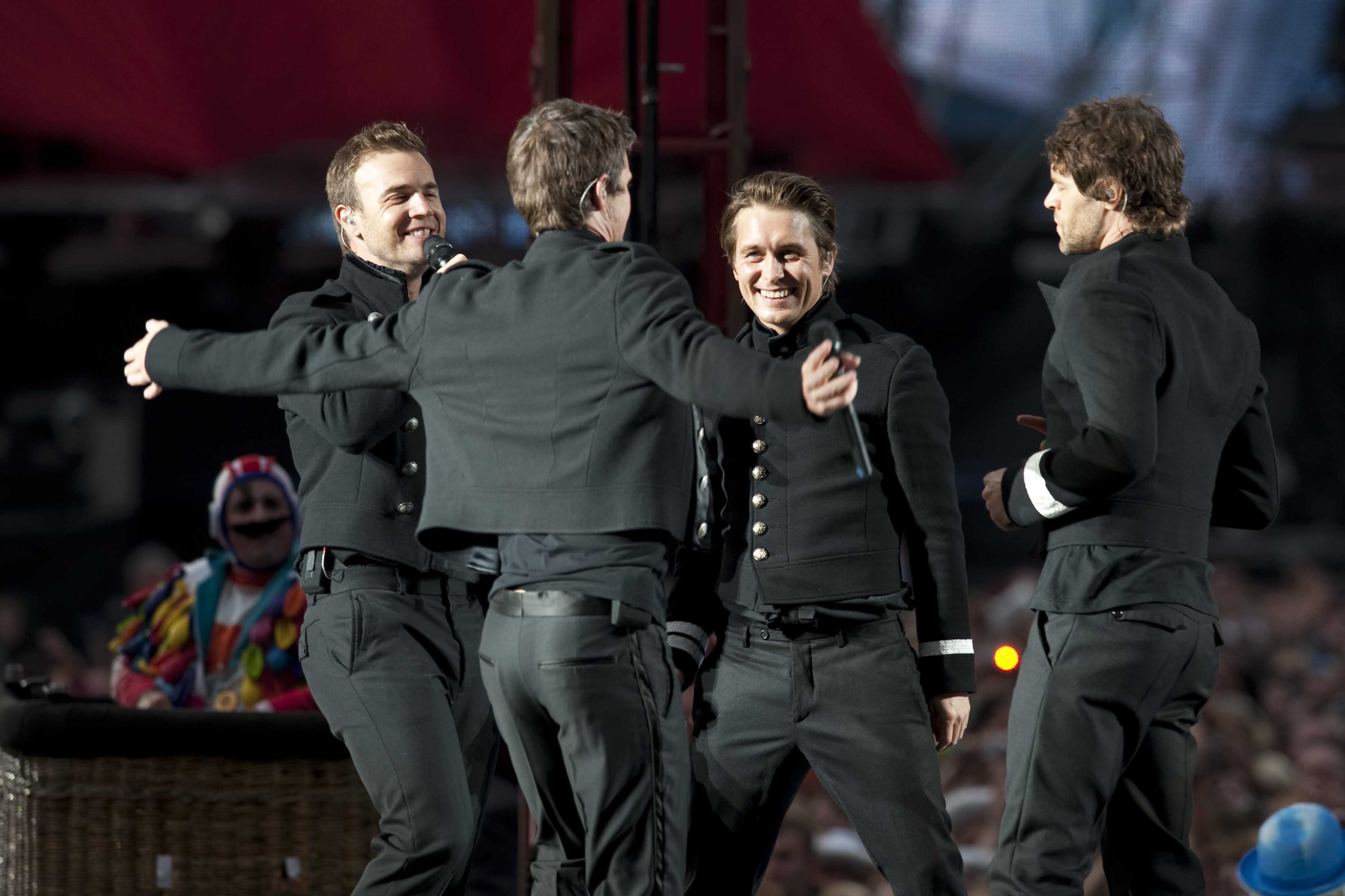 31839, GLASGOW, SCOTLAND - Friday June 19 2009. **UK PAPERS OUT** (L-R) Gary Barlow, Jason Orange, Mark Owen and Howard Donald of the reformed British boy band Take That take their Circus tour to Glasgow's Hampden Stadium., Image: 35550199, License: Rights-managed, Restrictions: UK PAPERS OUT, Model Release: no, Credit line: Profimedia, Pacific coast news