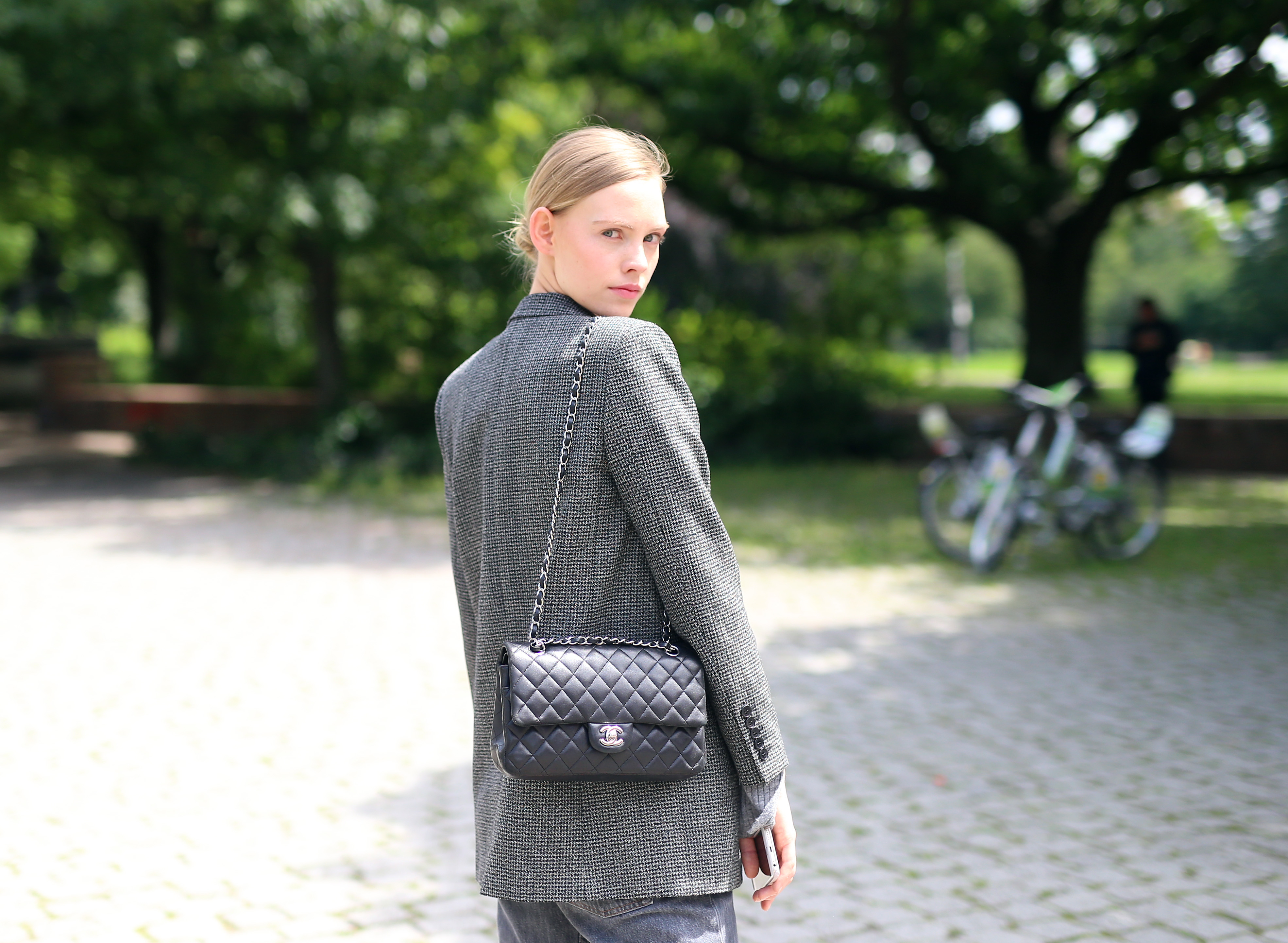 BERLIN, GERMANY - JULY 05:  Charlotte Nolting, wearing  Ysc blazer, Levi's vintage trousers, Chanel bag, Repetto pullover, is seen during the Mercedes-Benz Fashion Week Berlin Spring/Summer 2018 at Kaufhaus Jandorf on July 5, 2017 in Berlin, Germany.  (Photo by Joern Pollex/Getty Images)