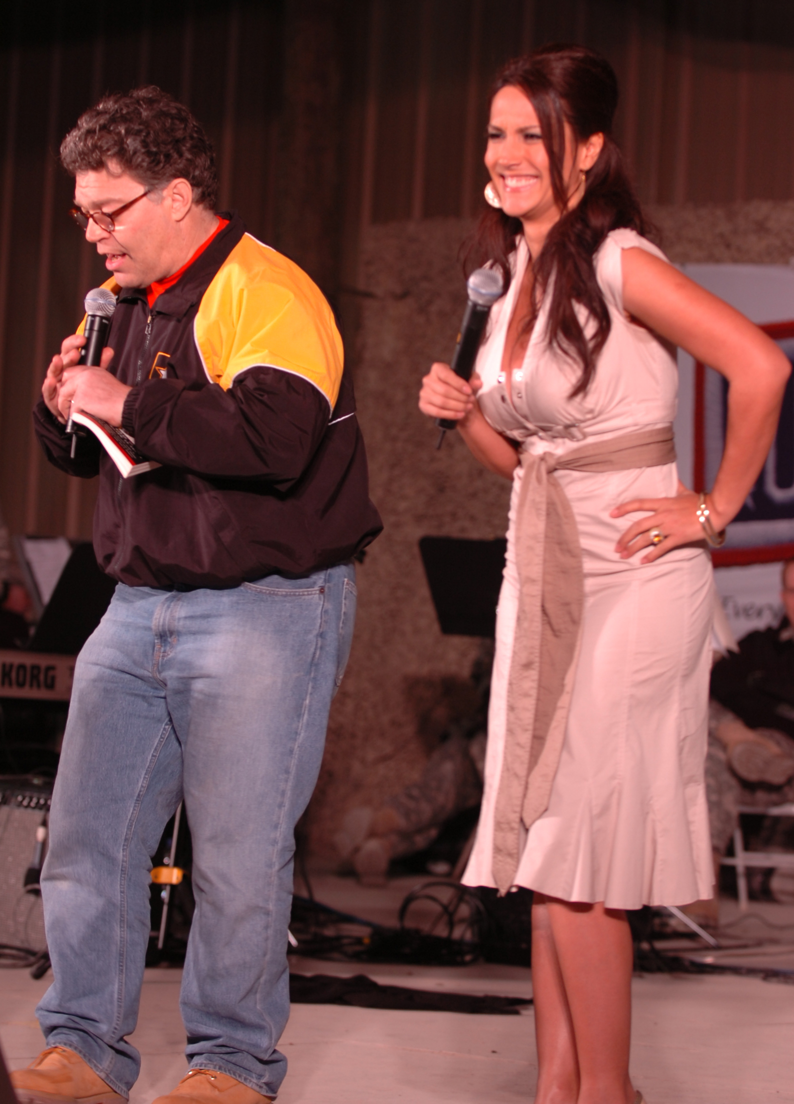 CAMP ARIFJAN,KUWAIT - DECEMBER 15: In this handout photofrom 2006  provided by the US Army, Comedian Al Franken and sports commentator Leeann Tweeden perform a comic skit on camp Thursday in front of more than 2,000 elated servicemembers during the USO Sergeant Major of the Army's 2006 Hope and Freedom Tour. Franken and Tweeden are touring with country music singers, Darryl Worley, Mark Wills, Keni Thomas, hip-hop artists (Phot by Patrick Moes/US Army via Getty Images)