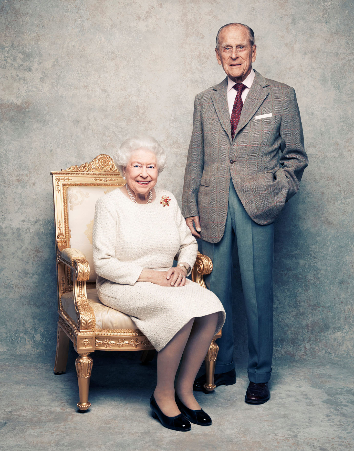 A handout photo shows Britain's Queen Elizabeth and Prince Philip in the White Drawing Room at Windsor Castle in early November, pictured against a platinum-textured backdrop, in celebration of their platinum wedding anniversary on November 20, 2017. Matt Holyoak/CameraPress/PA Wire/Handout via REUTERS      MANDATORY CREDIT. IMAGE IS PROVIDED FOR FREE EDITORIAL USE UNTIL DECEMBER 3RD. WHEN IT MUST BE REMOVED FROM ALL SYSTEMS AND THOSE OF YOUR SUBSCRIBERS. THIS PHOTOGRAPH IS STRICTLY FOR EDITORIAL USE ONLY, NO COMMERCIAL, SOUVENIR, COVERS OR PROMOTIONAL USE PERMITTED. THE PHOTOGRAPH CANNOT BE CROPPED, MANIPULATED OR ALTERED IN ANY WAY. THIS PICTURE WAS PROVIDED BY A THIRD PARTY. NO RESALES. NO ARCHIVE.