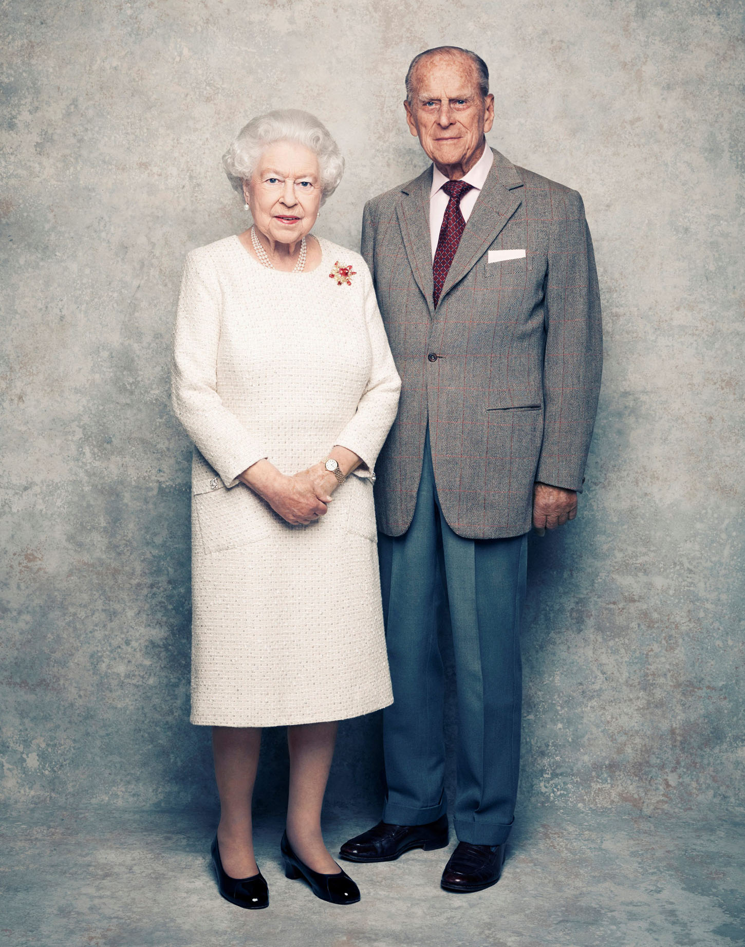 A handout photo shows Britain's Queen Elizabeth and Prince Philip in the White Drawing Room at Windsor Castle in early November, pictured against a platinum-textured backdrop, in celebration of their platinum wedding anniversary on November 20, 2017. Matt Holyoak/CameraPress/PA Wire/Handout via REUTERS      MANDATORY CREDIT. IMAGE IS PROVIDED FOR FREE EDITORIAL USE UNTIL DECEMBER 3RD. WHEN IT MUST BE REMOVED FROM ALL SYSTEMS AND THOSE OF YOUR SUBSCRIBERS. THIS PHOTOGRAPH IS STRICTLY FOR EDITORIAL USE ONLY, NO COMMERCIAL, SOUVENIR, COVERS OR PROMOTIONAL USE PERMITTED. THE PHOTOGRAPH CANNOT BE CROPPED, MANIPULATED OR ALTERED IN ANY WAY. THIS PICTURE WAS PROVIDED BY A THIRD PARTY. NO RESALES. NO ARCHIVE.     TPX IMAGES OF THE DAY