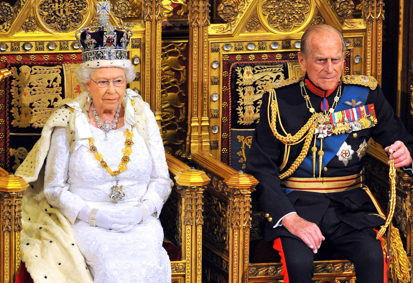 LONDON, ENGLAND - JUNE 04:  Queen Elizabeth II sits with Prince Philip, Duke of Edinburgh as she delivers her speech during the State Opening of Parliament in the House of Lords at the Palace of Westminster on June 4, 2014 in London, England. Queen Elizabeth II is to unveil the coalition government's legislative programme in a speech delivered to Members of Parliament and Peers in The House of Lords. Proposed legislation is expected to be introduced on a 5p charge for plastic bags in England, funding of workplace pensions, new state-funded childcare subsidy and reforms to speed up infrastructure projects.  (Photo by Ray Collins - WPA Pool/Getty Images)