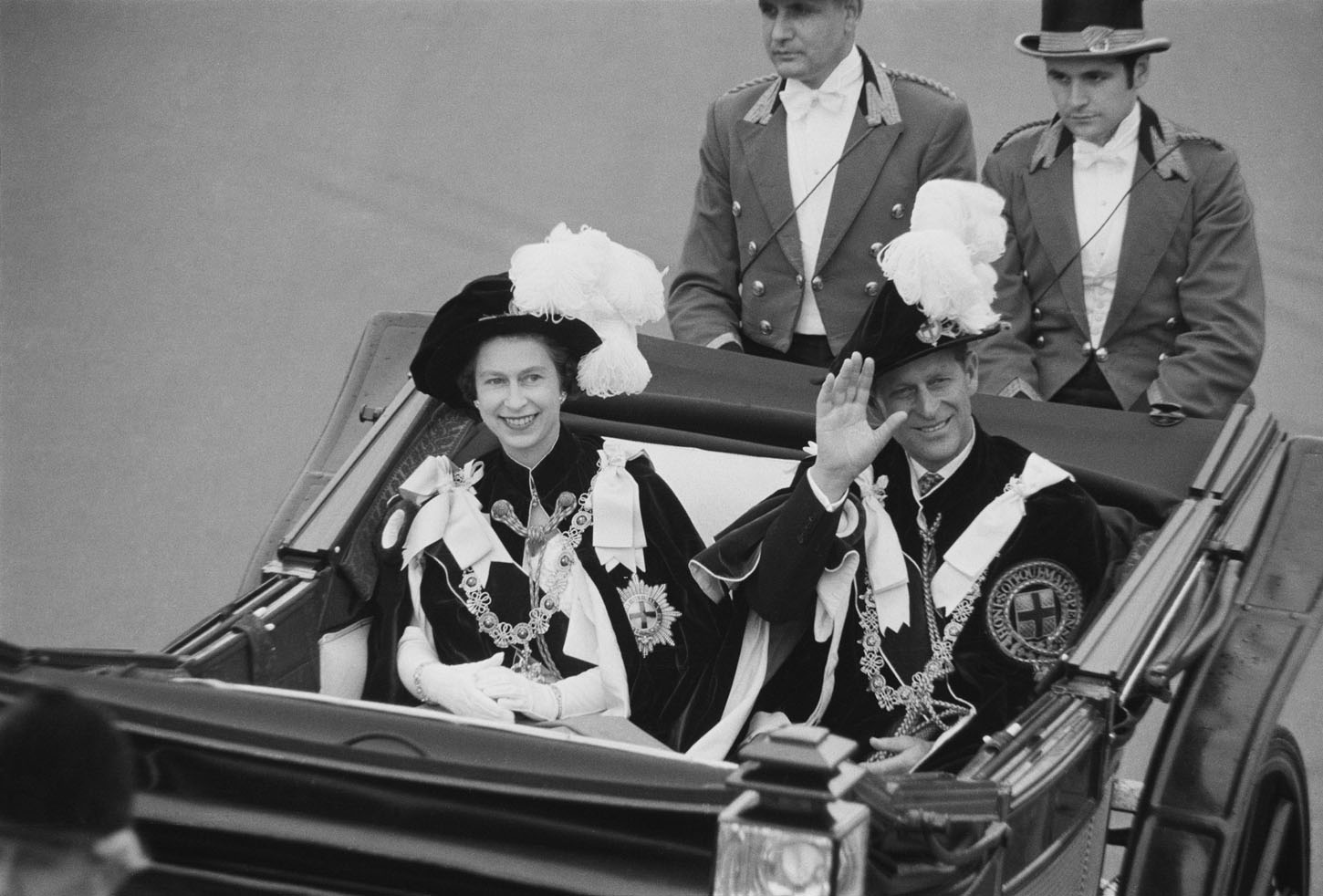 Prince Philip, Duke of Edinburgh and Queen Elizabeth II wave to crowds during the Garter Procession at Windsor Castle, 1969. (Photo by Victor Blackman/Daily Express/Hulton Archive/Getty Images)