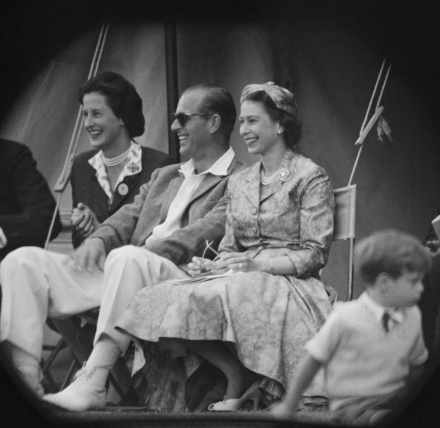 Queen Elizabeth II and Prince Philip, Duke of Edinburgh watch a cricket match at Highclere Castle, Highclere, Hampshire, 3rd August 1958.  (Photo by Victor Blackman/Daily Express/Hulton Archive/Getty Images)