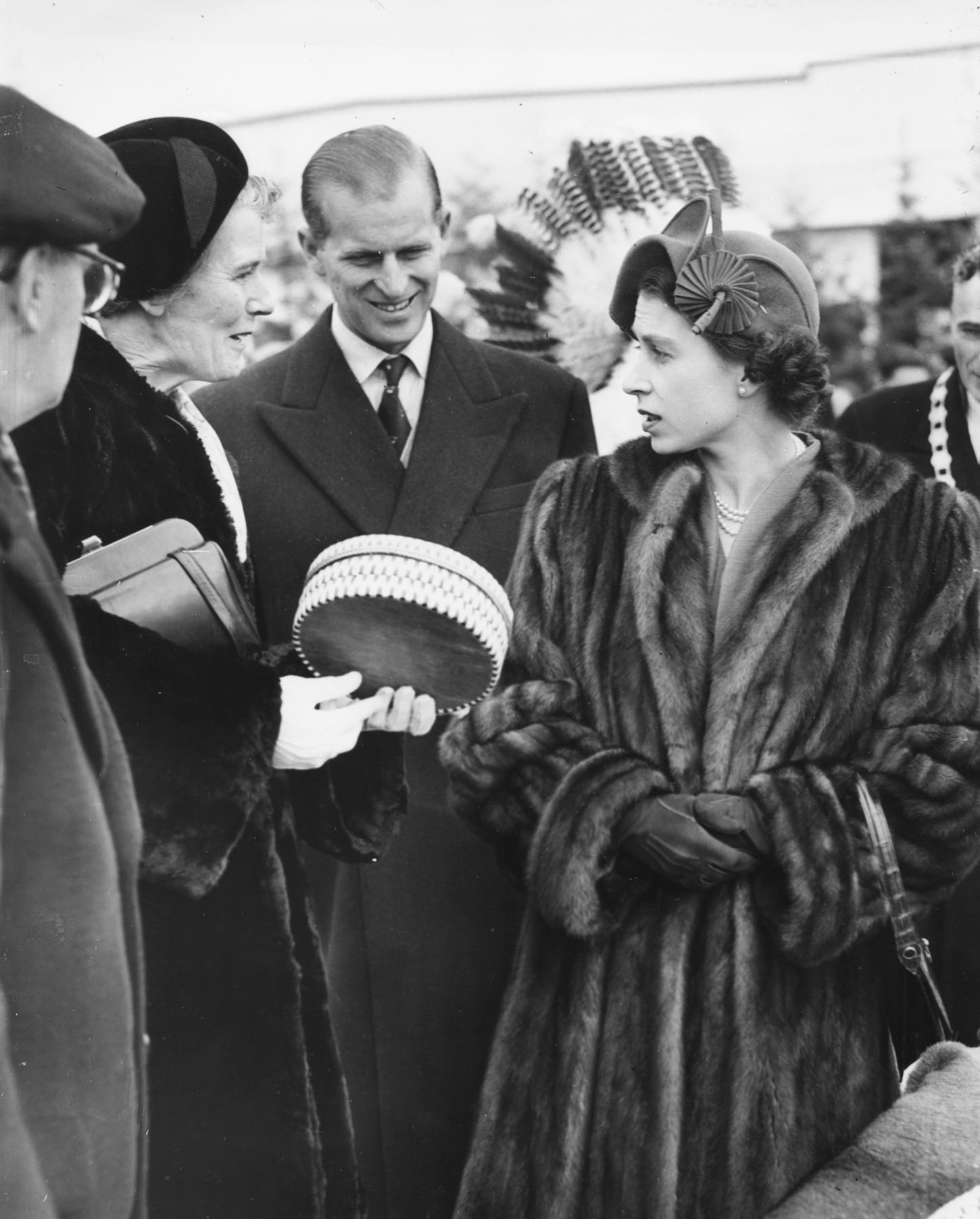 Princess Elizabeth and Prince Philip, the Duke of Edinburgh, admiring an Indian basket weave during a visit to Fort William in Ontario, November 2nd 1951. (Photo by Fox Photos/Hulton Archive/Getty Images)