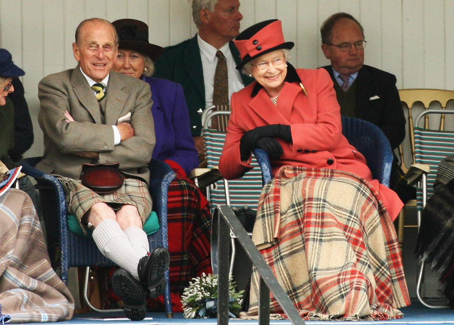 BRAEMAR, UNITED KINGDOM - SEPTEMBER 06:  TRH Queen Elizabeth II and Prince Philip, Duke of Edinburgh laugh as they watch the games during the Annual Braemar Highland Gathering on September 6, 2008 in Braemar, Scotland. The Braemar Gathering is the most famous of the Highland Games and is known Worldwide. Each year thousands of visitors descend on this small Scottish village on the first Saturday in September to watch one of the more colourful Scottish traditions. The Gathering has a long history and in its modern form it stretches back nearly 200 years.  (Photo by Chris Jackson/Getty Images)