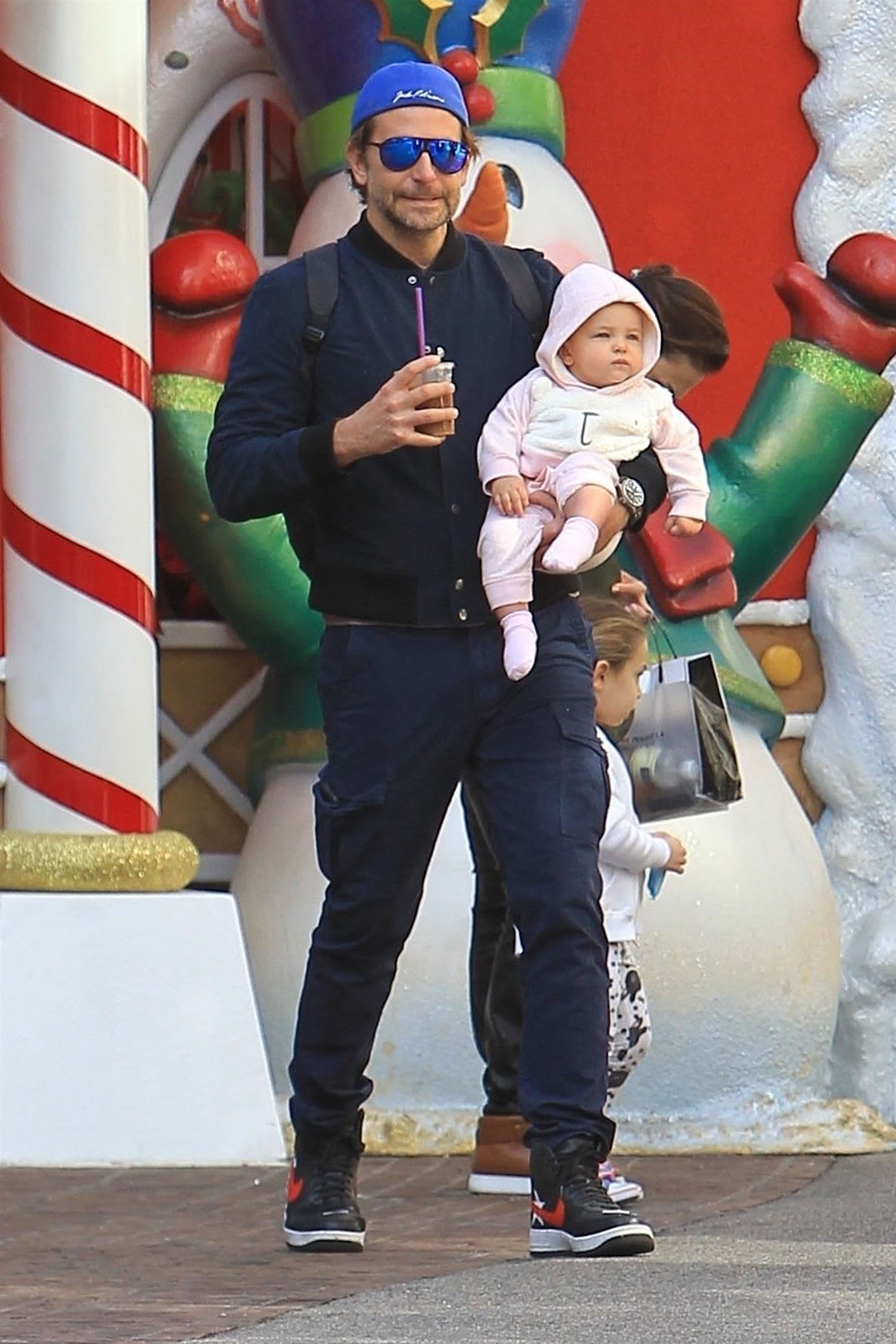 Los Angeles, CA  - *EXCLUSIVE*  **WEB MUST CALL FOR PRICING** - Couple Bradley Cooper and Irina Shayk take their daughter Lea De Seine Shayk Cooper to see Santa Claus at The Grove in Los Angeles. After sitting on Santa's lap Lea enjoyed being carried by her dad so she could see all the Christmas decorations at The Grove.  Pictured: Bradley Cooper, Lea De Seine Shayk Cooper  BACKGRID USA 18 NOVEMBER 2017, Image: 355664072, License: Rights-managed, Restrictions: , Model Release: no, Credit line: Profimedia, AKM-GSI