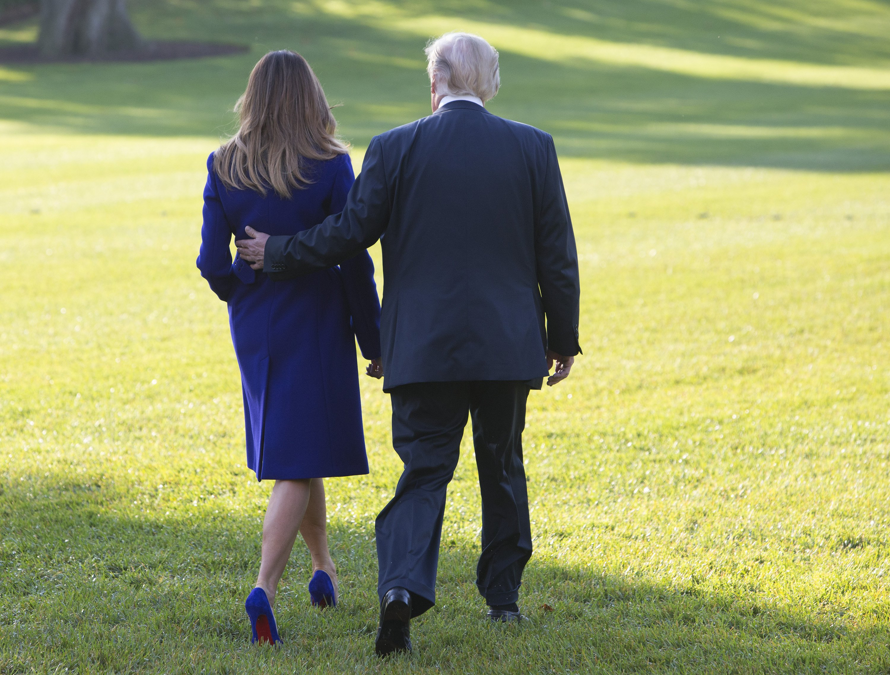 United States President Donald J. Trump and first lady Melania Trump walk on the South Lawn as they depart the White House in Washington, DC, November 3, 2017 for a multi-day trip to Hawaii and then on to Asia. Photo, Image: 354583936, License: Rights-managed, Restrictions: , Model Release: no, Credit line: Profimedia, Insight Media