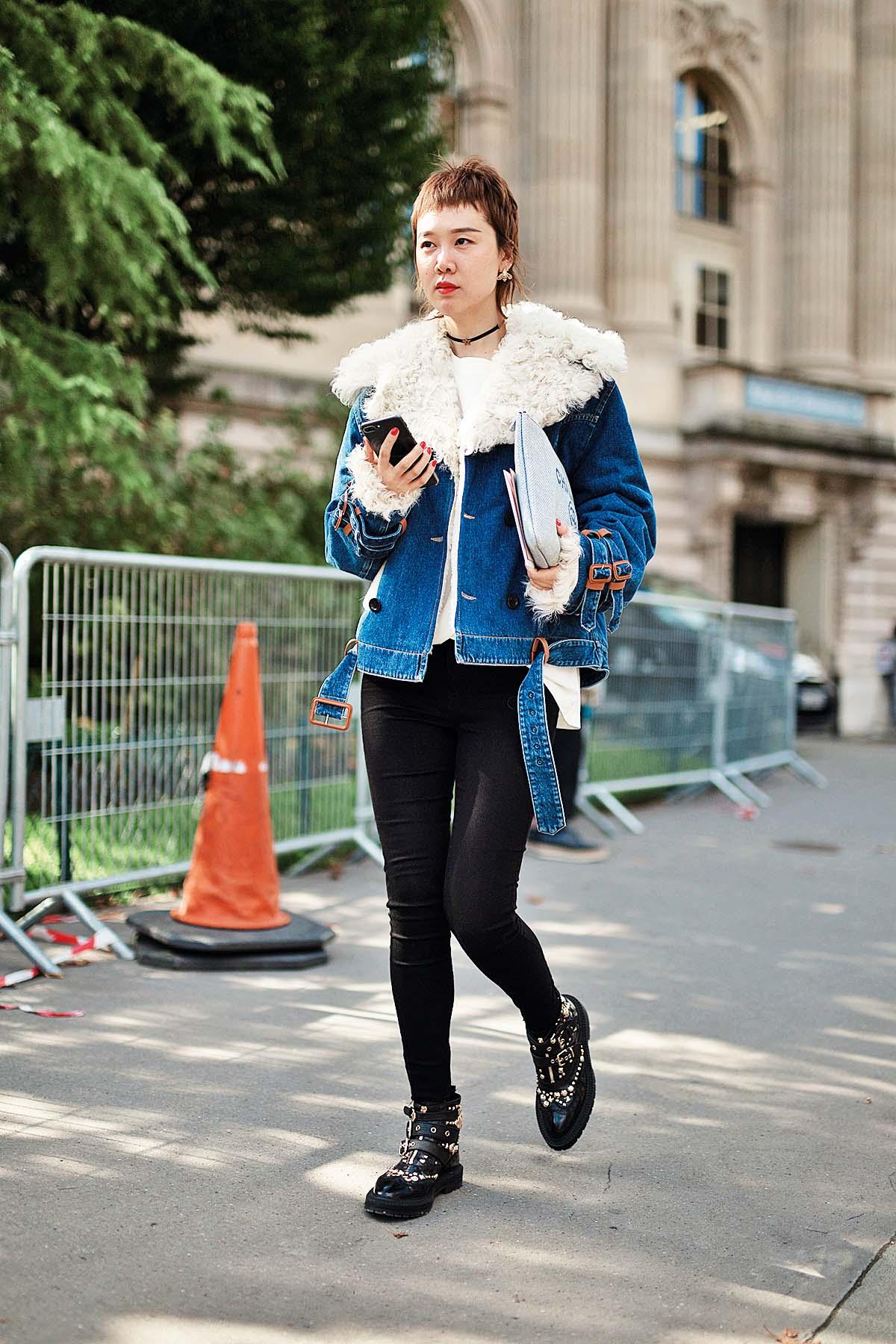 PARIS, FRANCE - OCTOBER 03:  A guest is seen attending Moncler Gamme Rouge during Paris Fashion Week wearing Moncler on October 3, 2017 in Paris, France.  (Photo by Matthew Sperzel/Getty Images)