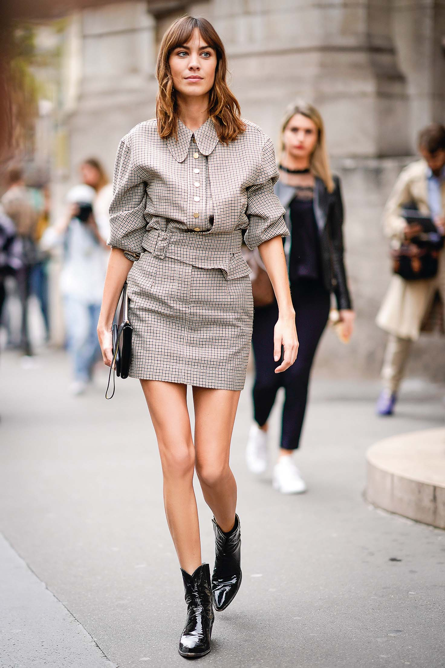 PARIS, FRANCE - OCTOBER 02:  Alexa Chung wears a checkered dress, outside Stella Mccartney, during Paris Fashion Week Womenswear Spring/Summer 2018, on October 2, 2017 in Paris, France.  (Photo by Edward Berthelot/Getty Images)