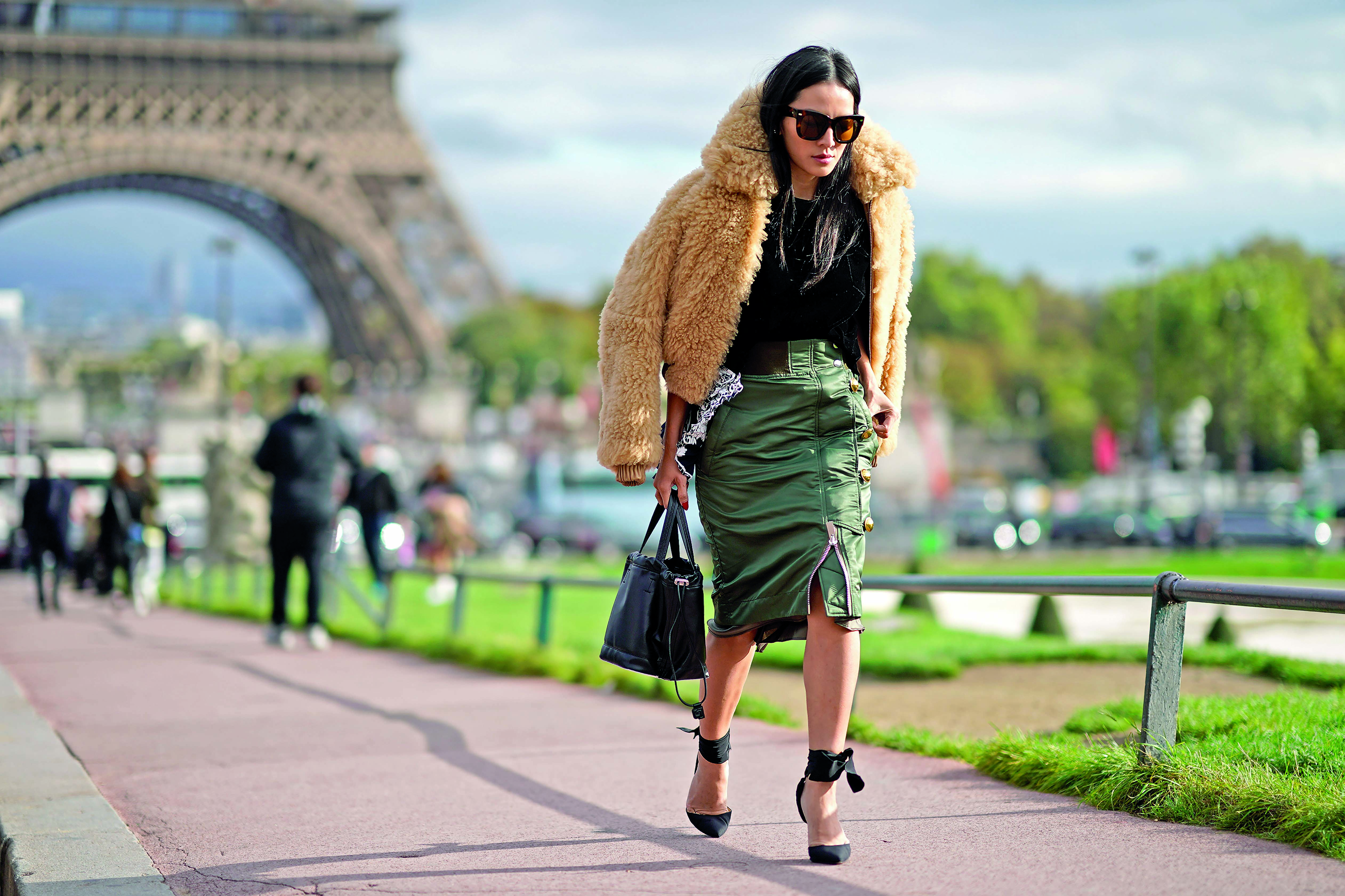 PARIS, FRANCE - OCTOBER 02:  Tina Leung wears a fur coat, a black top, a green skirt, outside Hermes, during Paris Fashion Week Womenswear Spring/Summer 2018, on October 2, 2017 in Paris, France.  (Photo by Edward Berthelot/Getty Images)