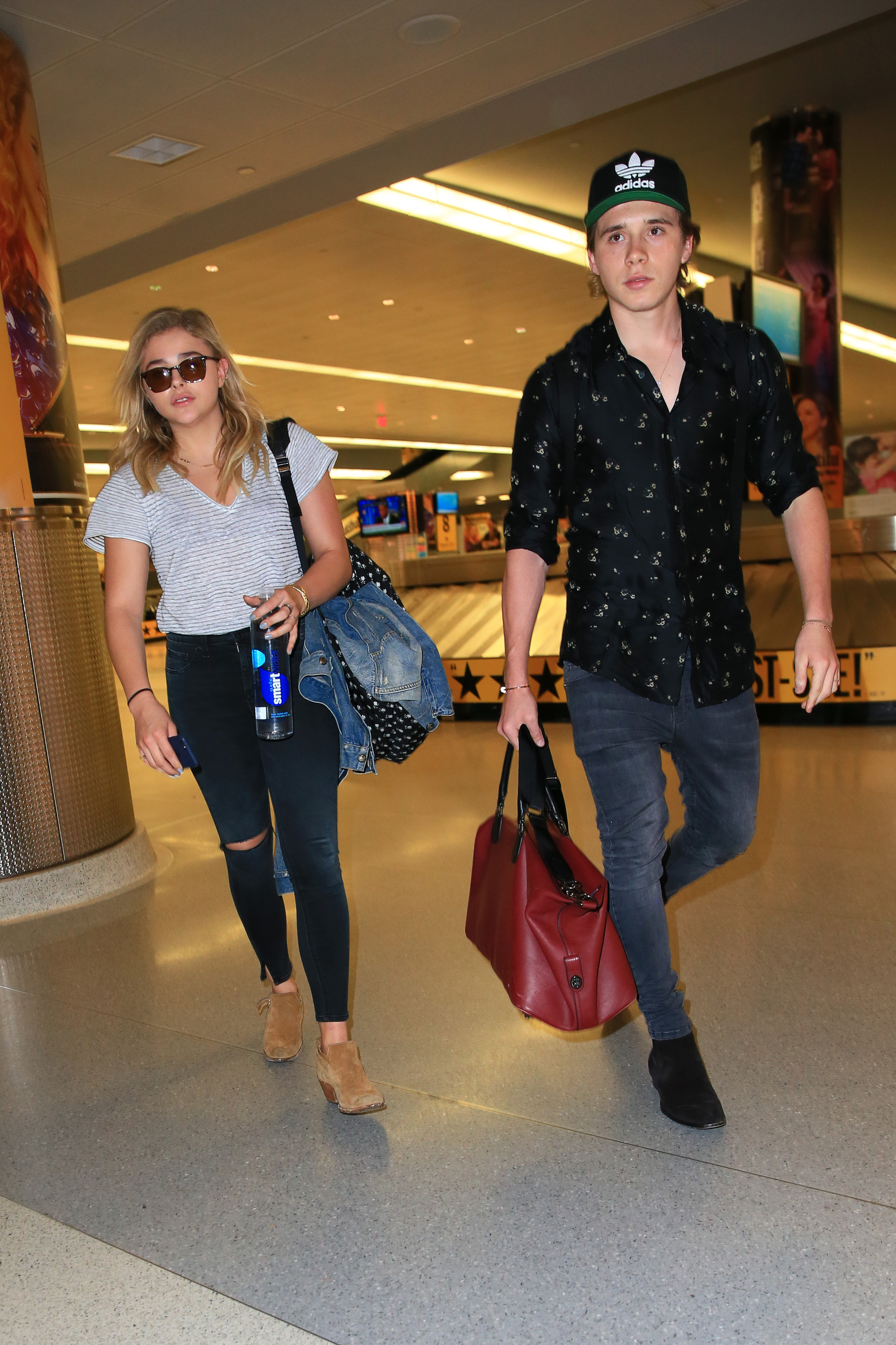 June 27, 2016: Chloe Moretz and her boyfriend Brooklyn Beckham are photographed tonight arriving at JFK International Airport in New York city <P> Pictured: Chloe Moretz, Brooklyn Beckham <B>Ref: SPL1612831  301017  </B><BR/> Picture by: Elder Ordonez / Splash News<BR/> </P><P> <B>Splash News and Pictures</B><BR/> Los Angeles:310-821-2666<BR/> New York:212-619-2666<BR/> London:870-934-2666<BR/> <span id=