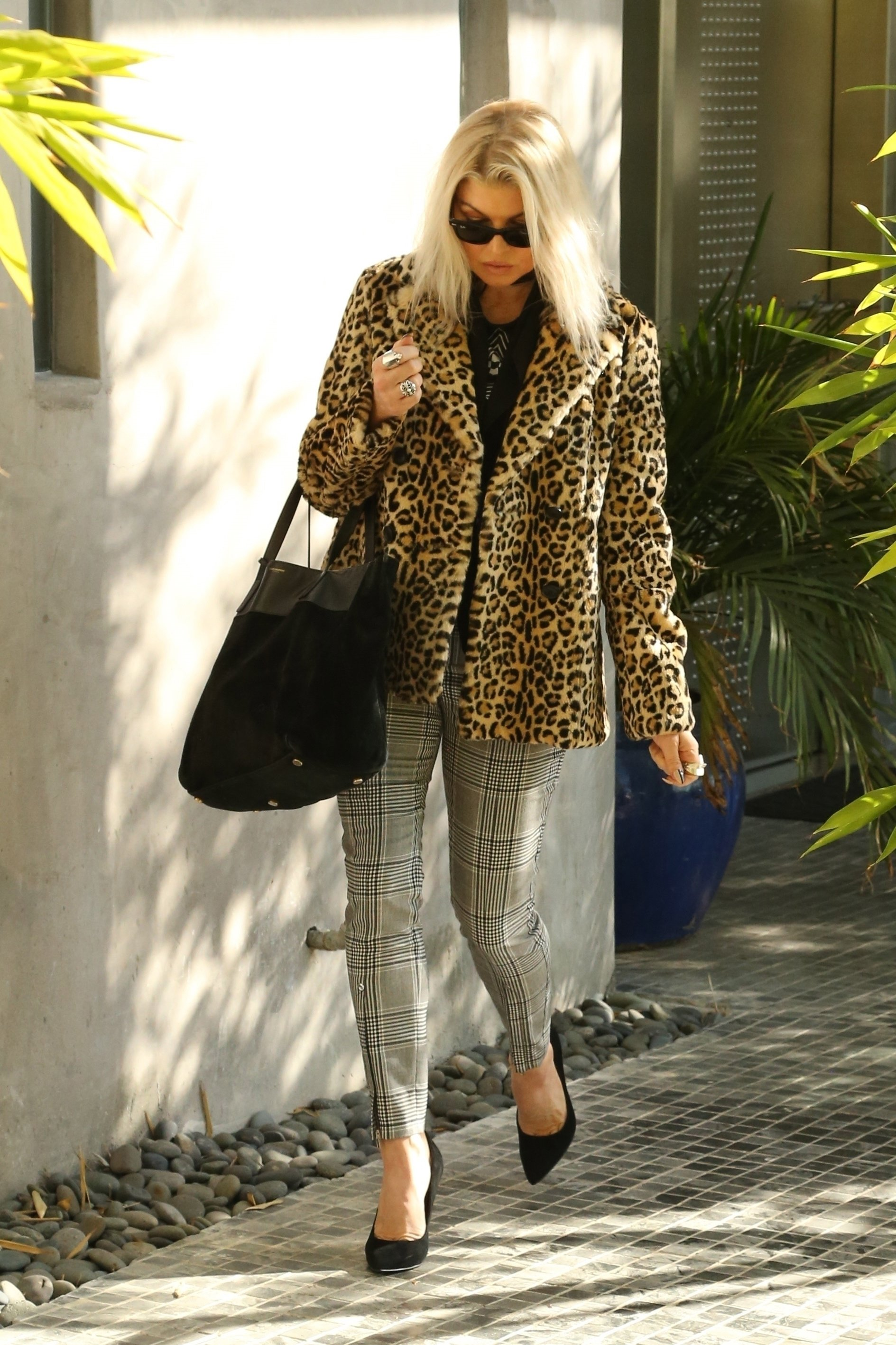 Los Angeles, CA  - *EXCLUSIVE*  - Fergie shows off her unique fashion sense as she hops into her limo. Fergie looks great in sunglasses, a leopard printed coat, black top, plaid pants, black pumps, and a black Saint Laurent tote bag.  Pictured: Fergie  BACKGRID USA 30 NOVEMBER 2017, Image: 356578846, License: Rights-managed, Restrictions: , Model Release: no, Credit line: Profimedia, AKM-GSI
