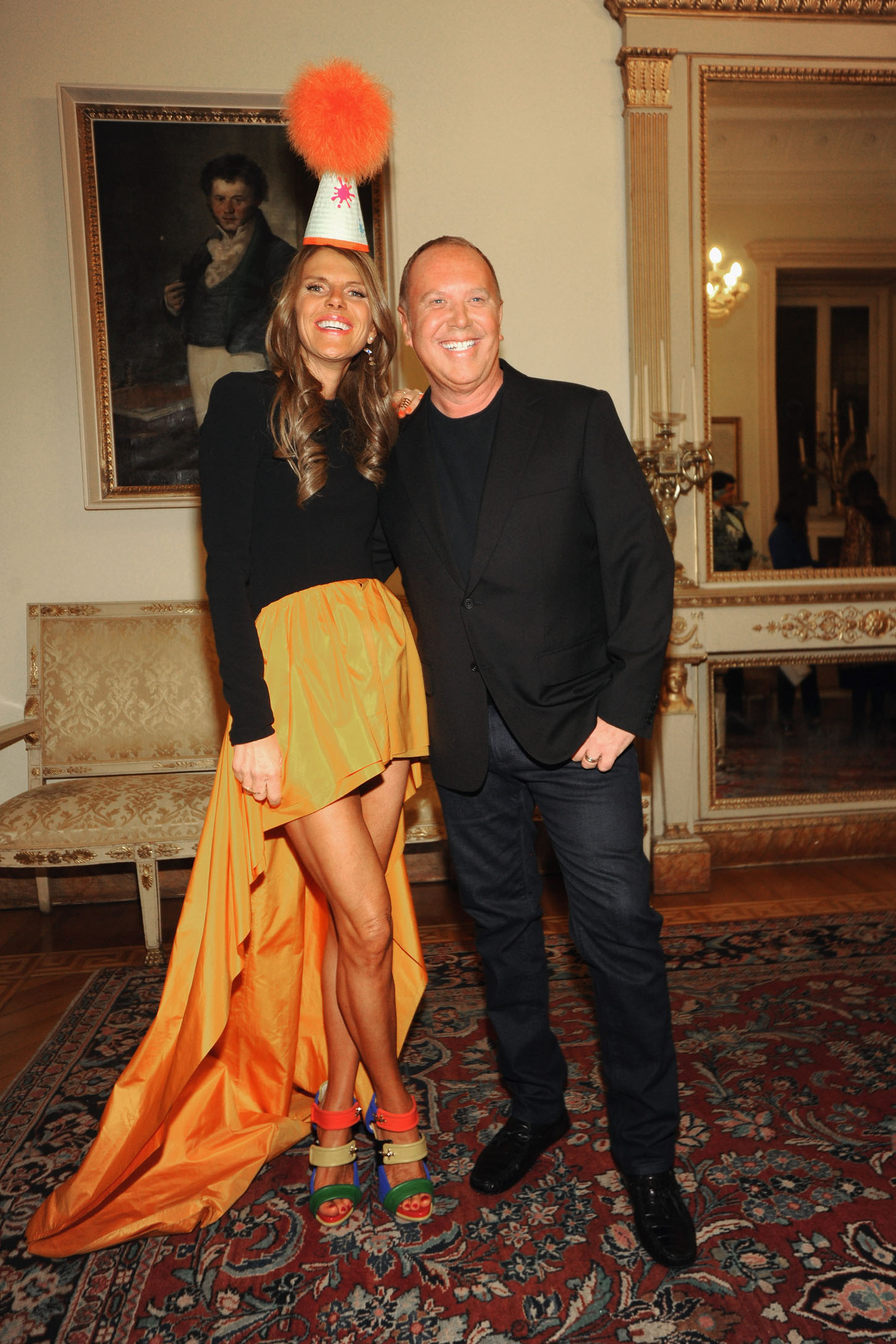 MILAN, ITALY - DECEMBER 04:  Anna Dello Russo and Designer Michael Kors attend Michael Kors to celebrate Milano cocktail arrivals on December 4, 2013 in Milan, Italy.  (Photo by Pier Marco Tacca/Getty Images for Michael Kors)