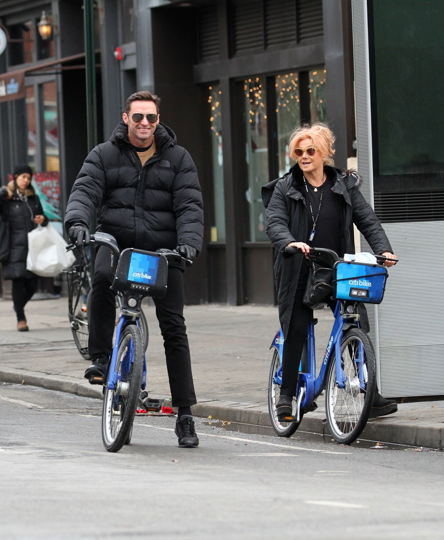 New York, NY  - Golden Globe Nominee Hugh Jackman is all smiles while riding Citibikes with Wife Deborra-Lee Furness in Manhattan's West Village neighborhood. Hugh was recently nominated as