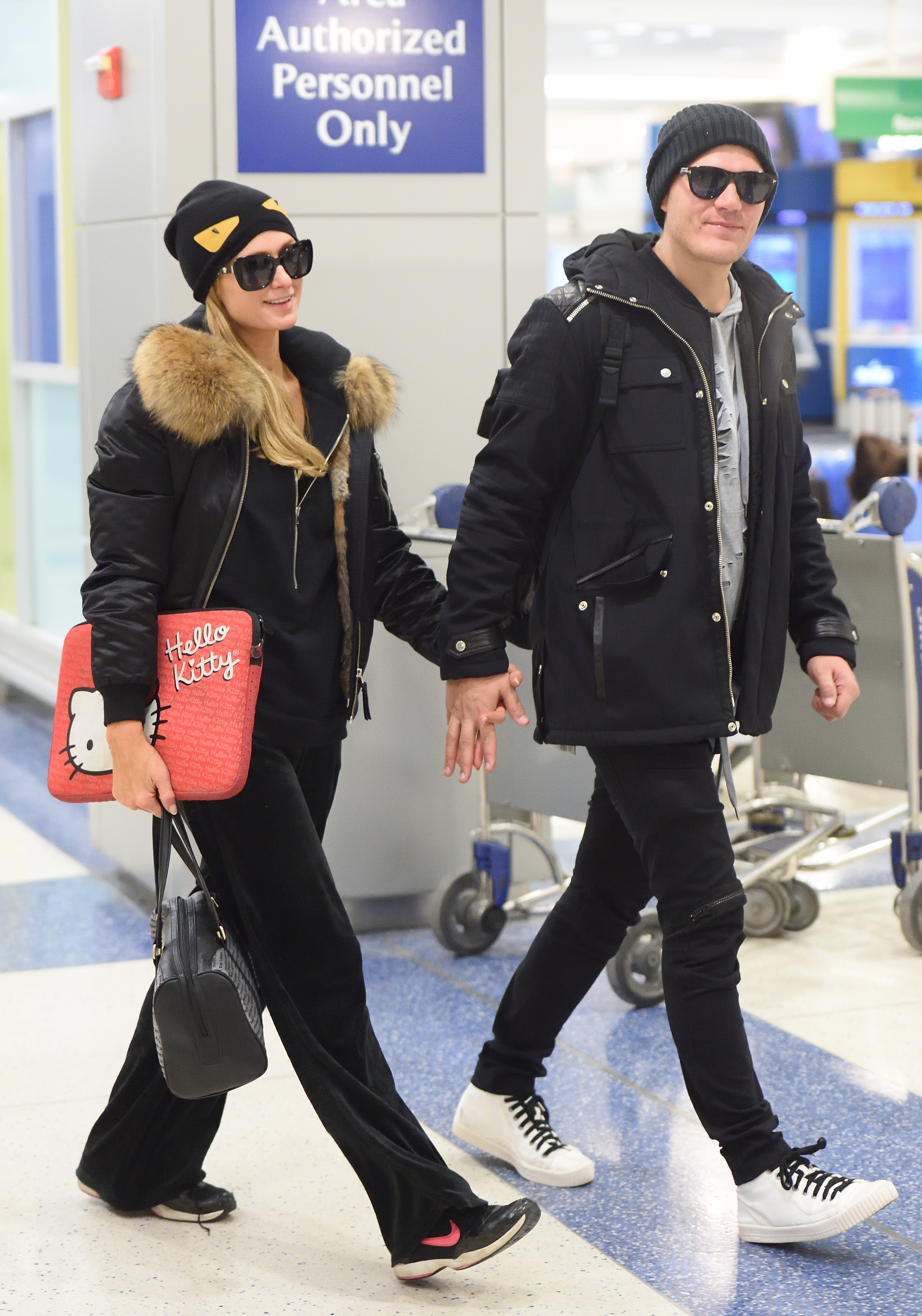 EXCLUSIVE: Paris Hilton with boyfriend Chris Zylka arrive hand in hand at JFK airport in NYC. <P> Pictured: Paris Hilton and Chris Zylka <B>Ref: SPL1638717  201217   EXCLUSIVE</B><BR/> Picture by: Ron Asadorian / Splash News<BR/> </P><P> <B>Splash News and Pictures</B><BR/> Los Angeles:310-821-2666<BR/> New York:212-619-2666<BR/> London:870-934-2666<BR/> <span id=