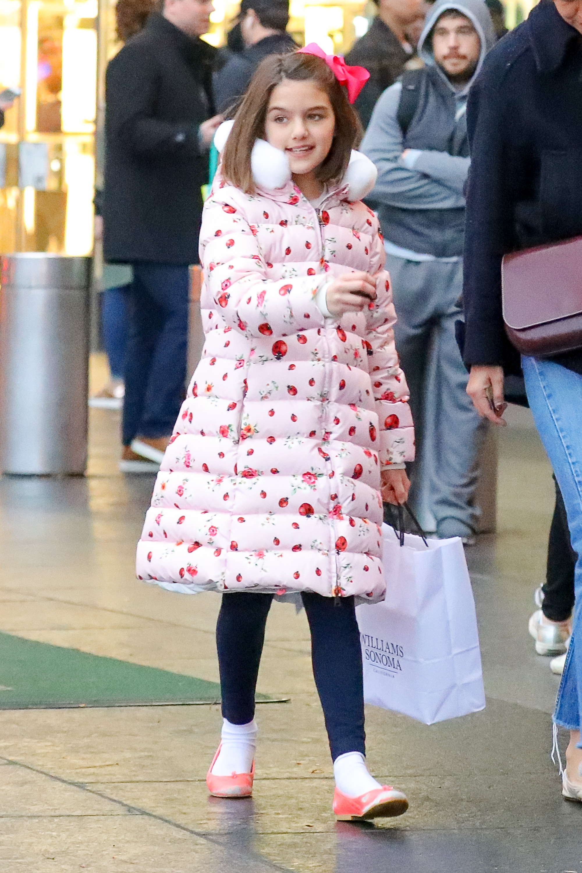 EXCLUSIVE: Suri Cruise wore Dolce & Gabbana Ladybug Puffer Jacket while out shopping with her mom Katie in Columbus Circle in NYC <P> Pictured: Suri Cruise <B>Ref: SPL1632744  041217   EXCLUSIVE</B><BR/> Picture by: Felipe Ramales / Splash News<BR/> </P><P> <B>Splash News and Pictures</B><BR/> Los Angeles:310-821-2666<BR/> New York:212-619-2666<BR/> London:870-934-2666<BR/> <span id=