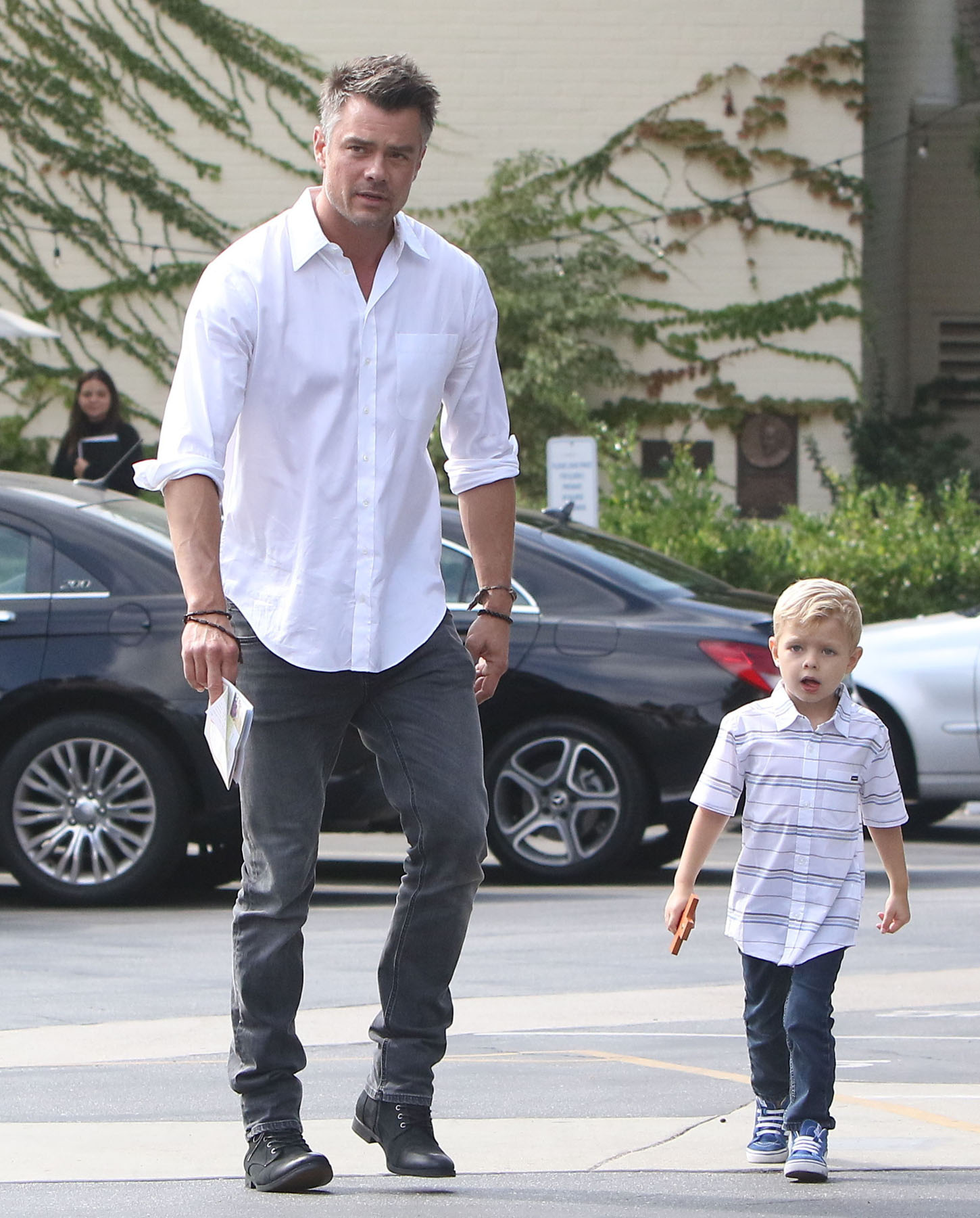 Dad Josh Duhamel carries son Axl into church services, early Sunday Morning.  Josh and Axl were both dressed nicely, in sharp button-up shirts.  Josh, was again without his ring, separated from mom, Fergie, who is attending Fashion Week in Paris.  October 1, 2017  X17online.com
