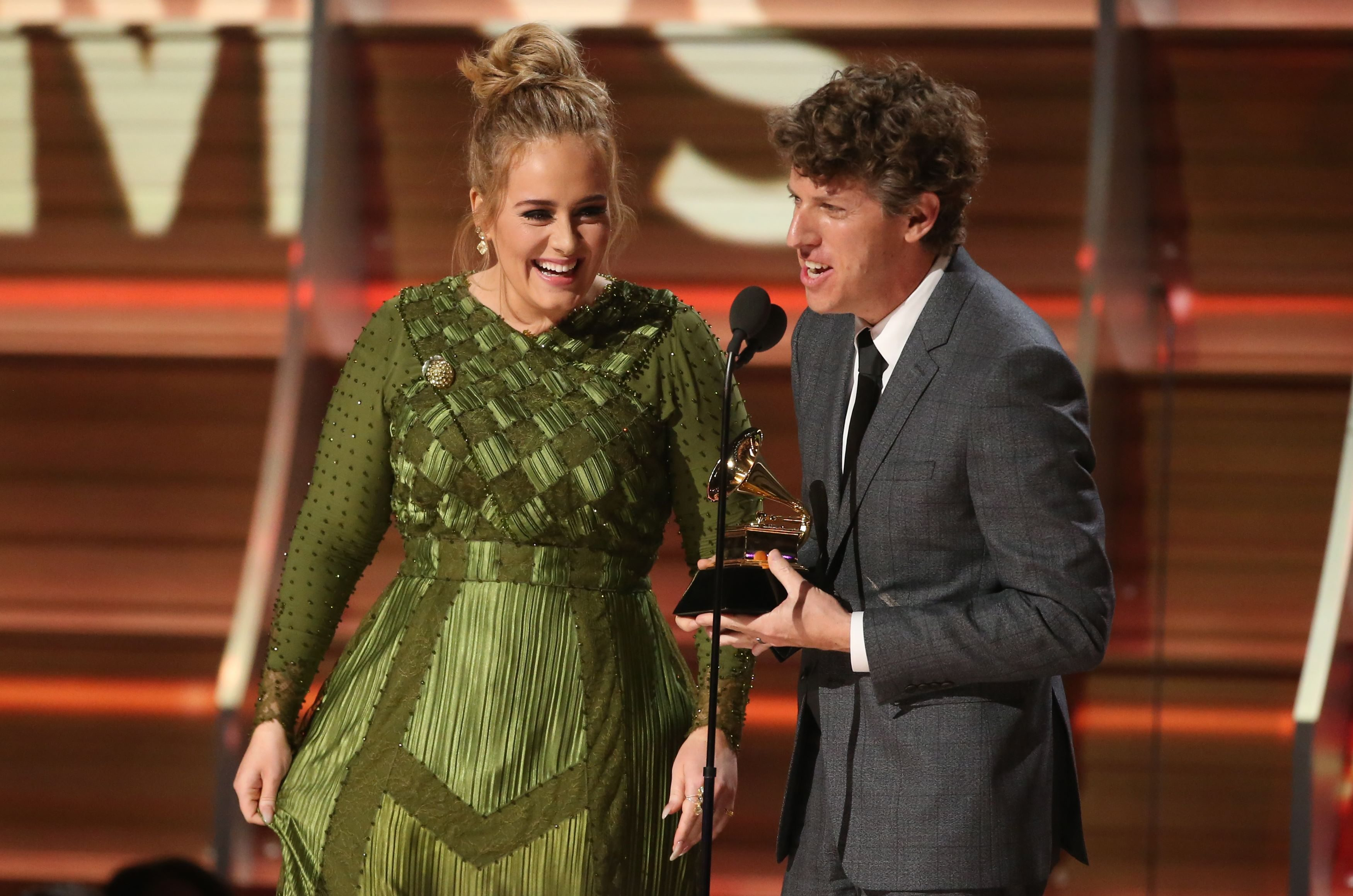 Adele and co writer Greg Kurstin accept the Grammy for Record of the Year for