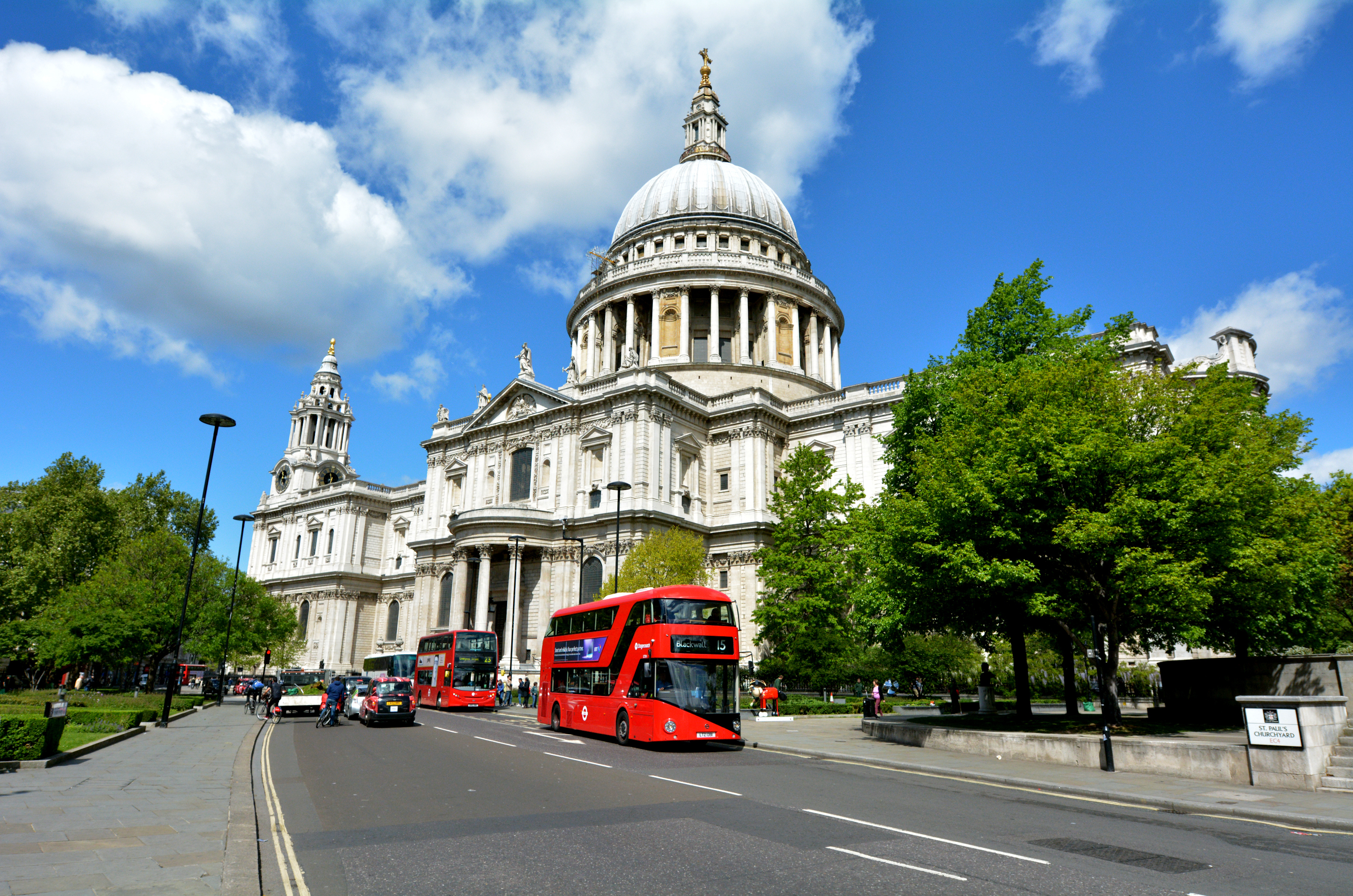 London, United Kingdom - May 12, 2015: Red tourist buses outside St Pauls Cathedral London England, UK.The cathedral is one of the most famous and most recognisable sights of London.St Paul's also possesses Europe largest crypt.