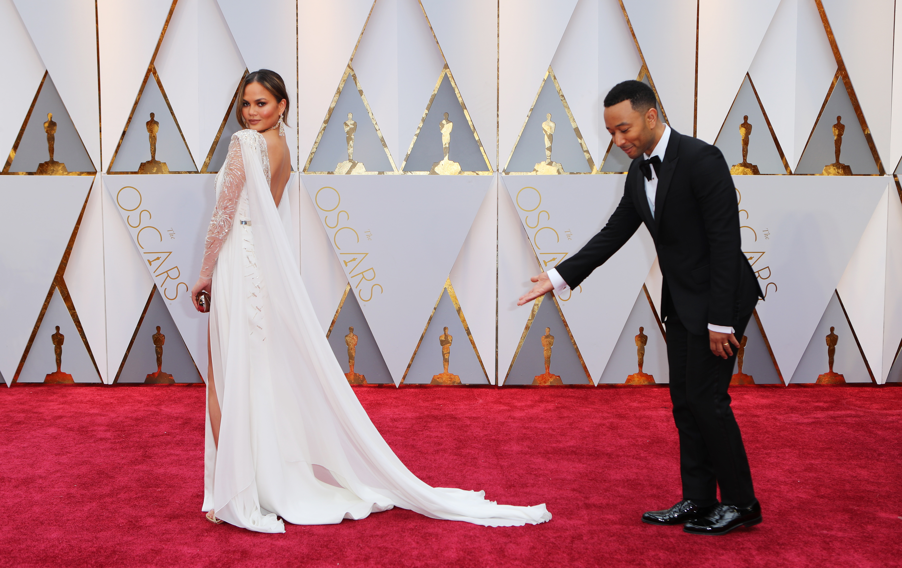 89th Academy Awards - Oscars Red Carpet Arrivals - Hollywood, California, U.S. - 26/02/17 - Chrissy Teigen and John Legend. REUTERS/Mike Blake - RTS10GMG