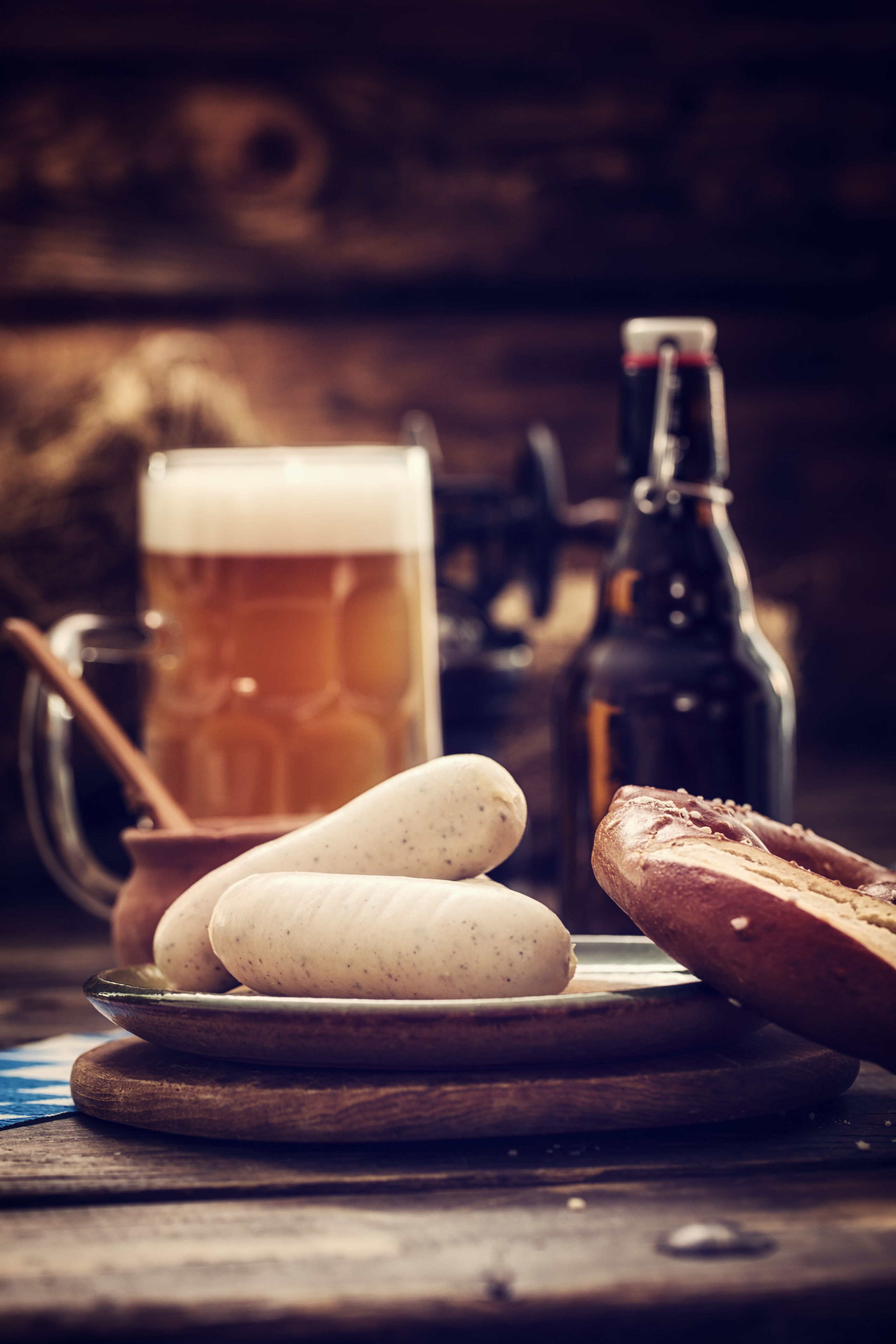 Traditional bavarian white sausages with pretzles and beer