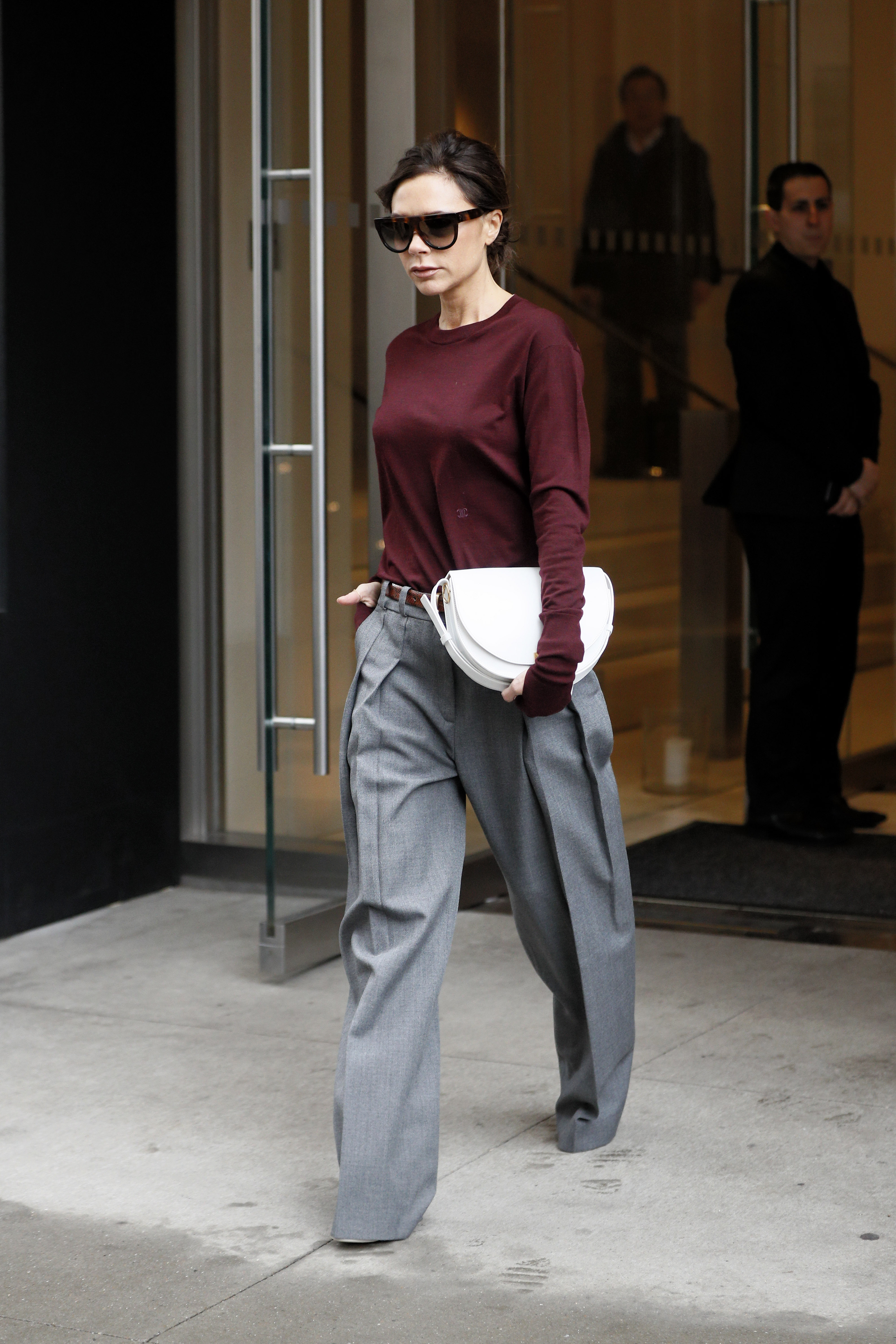 Fashion designer Victoria Beckham, wearing gray pants, burgundy sweater and white half moon purse, leaves the Edition Hotel in New York City <P> Pictured: Victoria Beckham <B>Ref: SPL1435948  070217  </B><BR/> Picture by: Christopher Peterson/Splash News<BR/> </P><P> <B>Splash News and Pictures</B><BR/> Los Angeles:310-821-2666<BR/> New York:212-619-2666<BR/> London:870-934-2666<BR/> <span id=