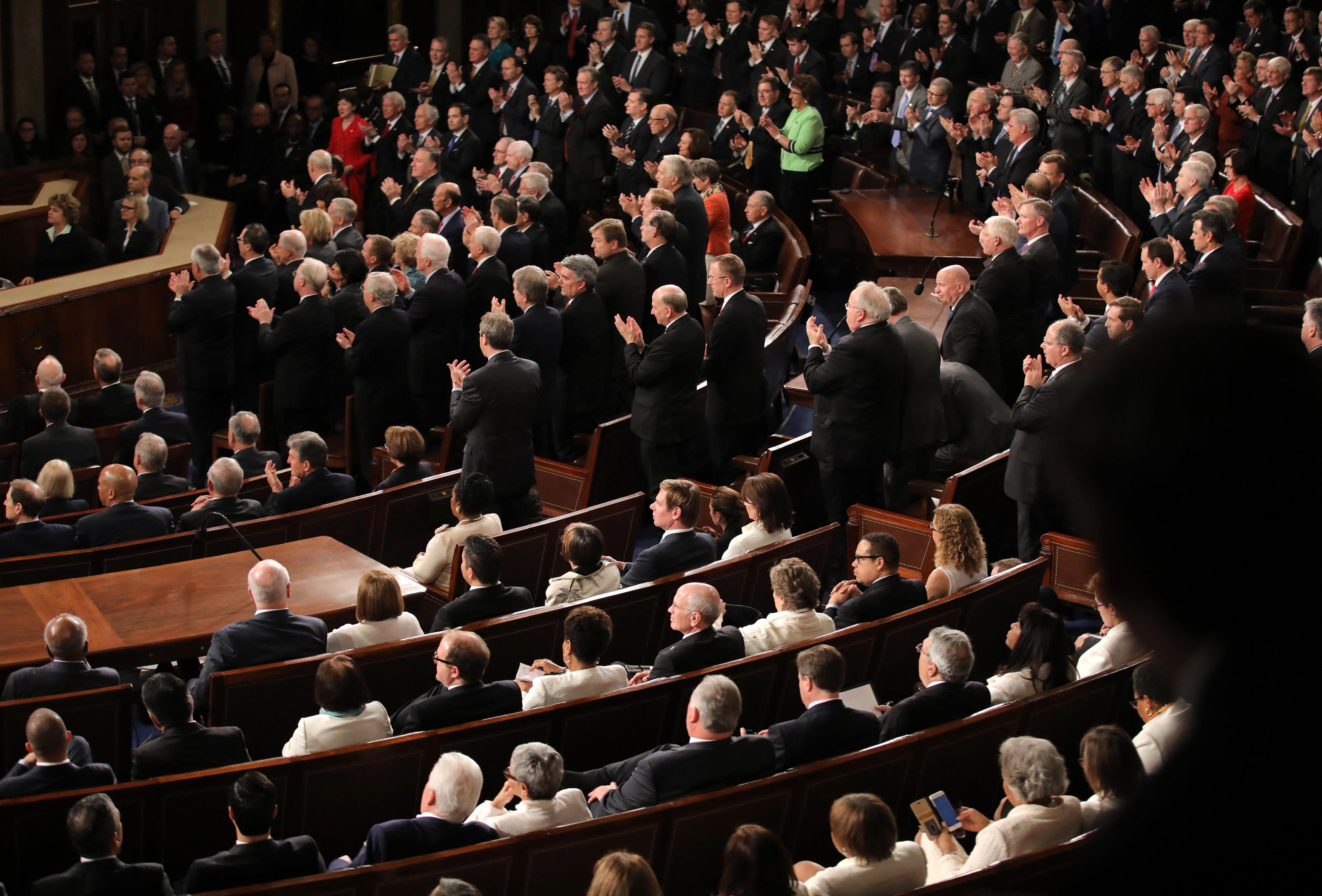 U.S. Trump Addresses Joint Session of Congress - Washington, U.S. 28/02/17 - Republican members of Congress stand and Democrats remain seated as President Donald Trump speaks. REUTERS/Carlos Barria