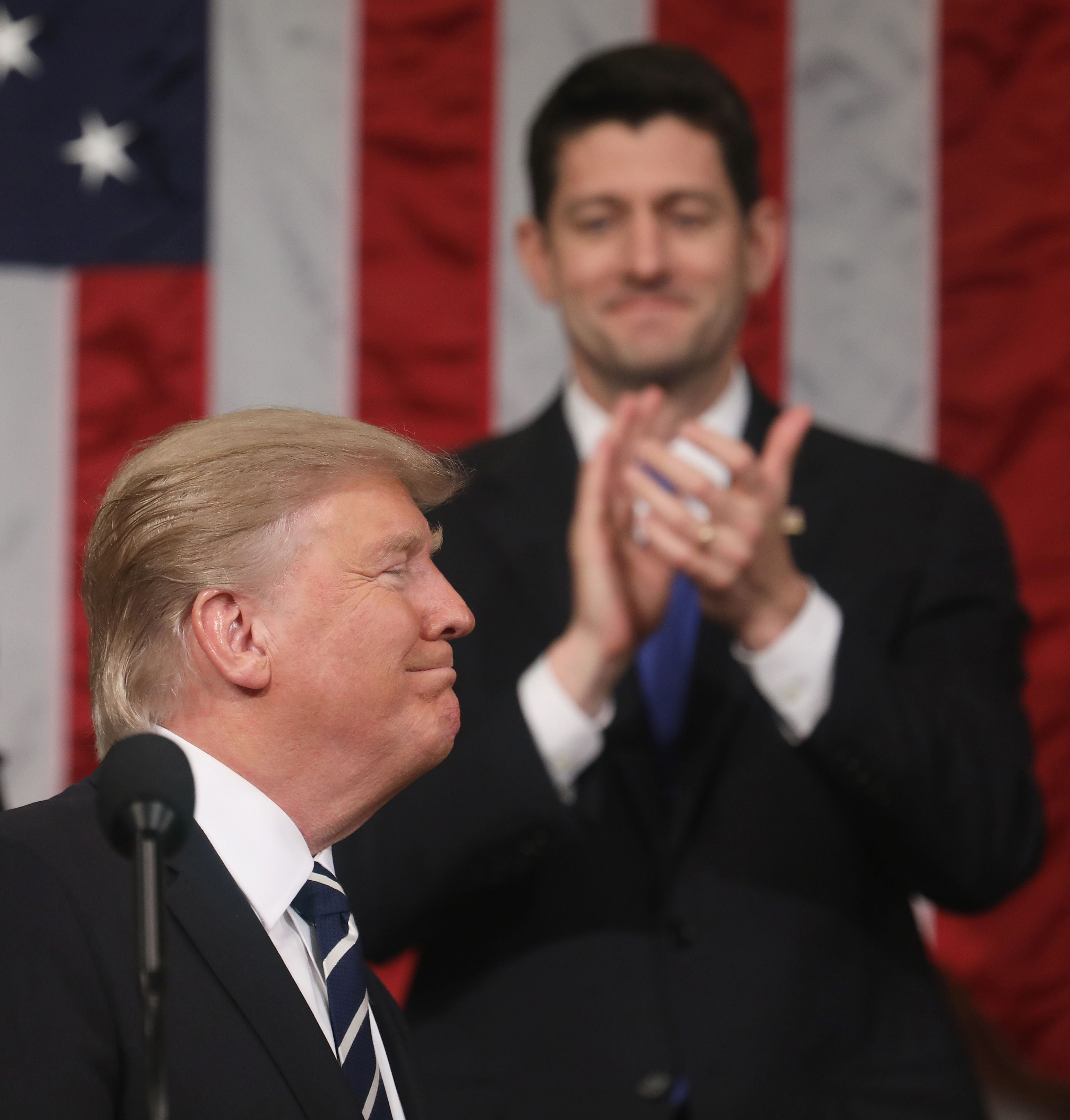 Speaker of the House Paul Ryan (R) applauds as U.S. President Donald Trump delivers his first address to a joint session of Congress from the floor of the House of Representatives iin Washington, U.S., February 28, 2017.  REUTERS/Jim Lo Scalzo/Pool