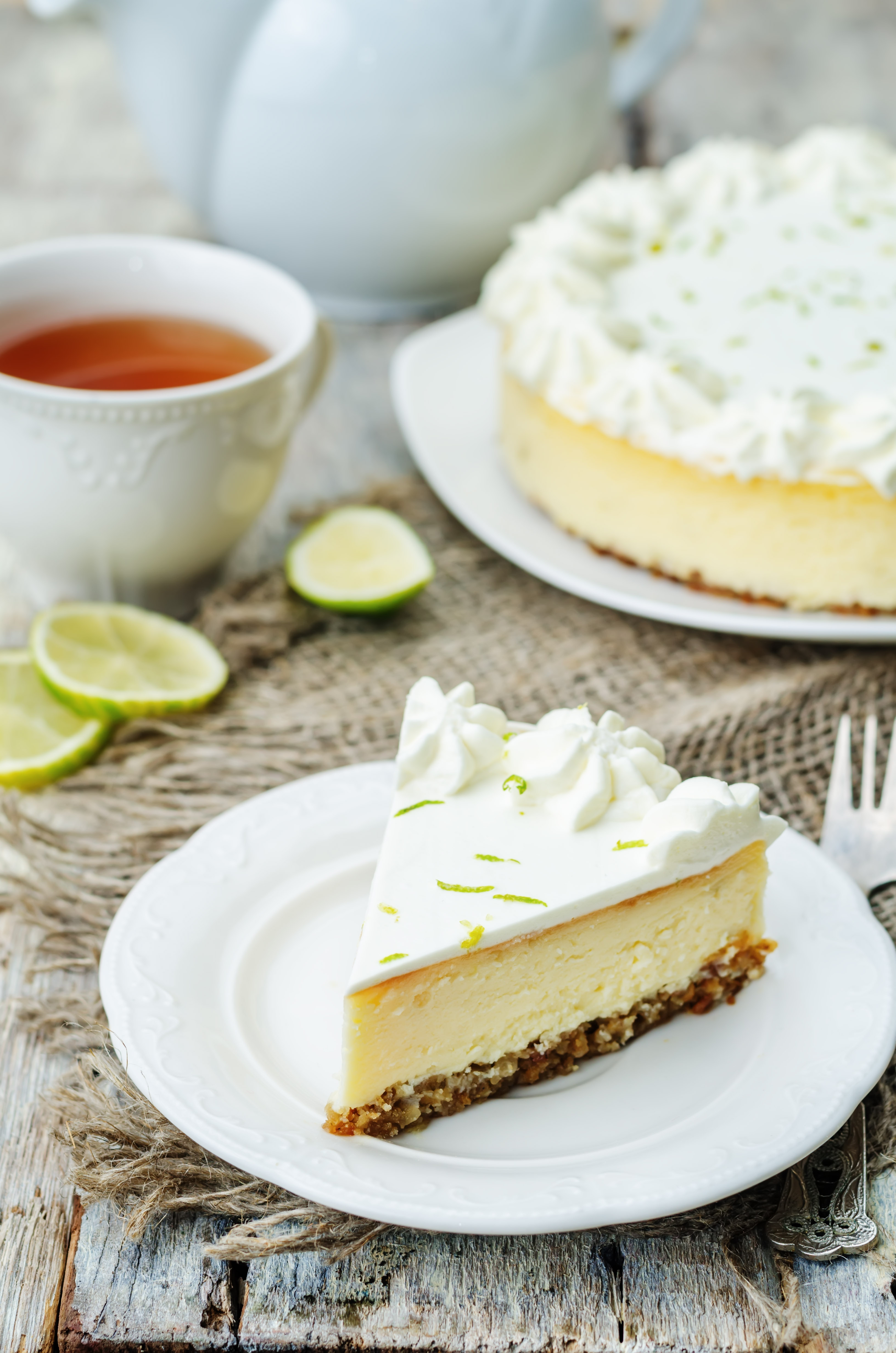 lime cheesecake on a white wood background. toning. selective focus