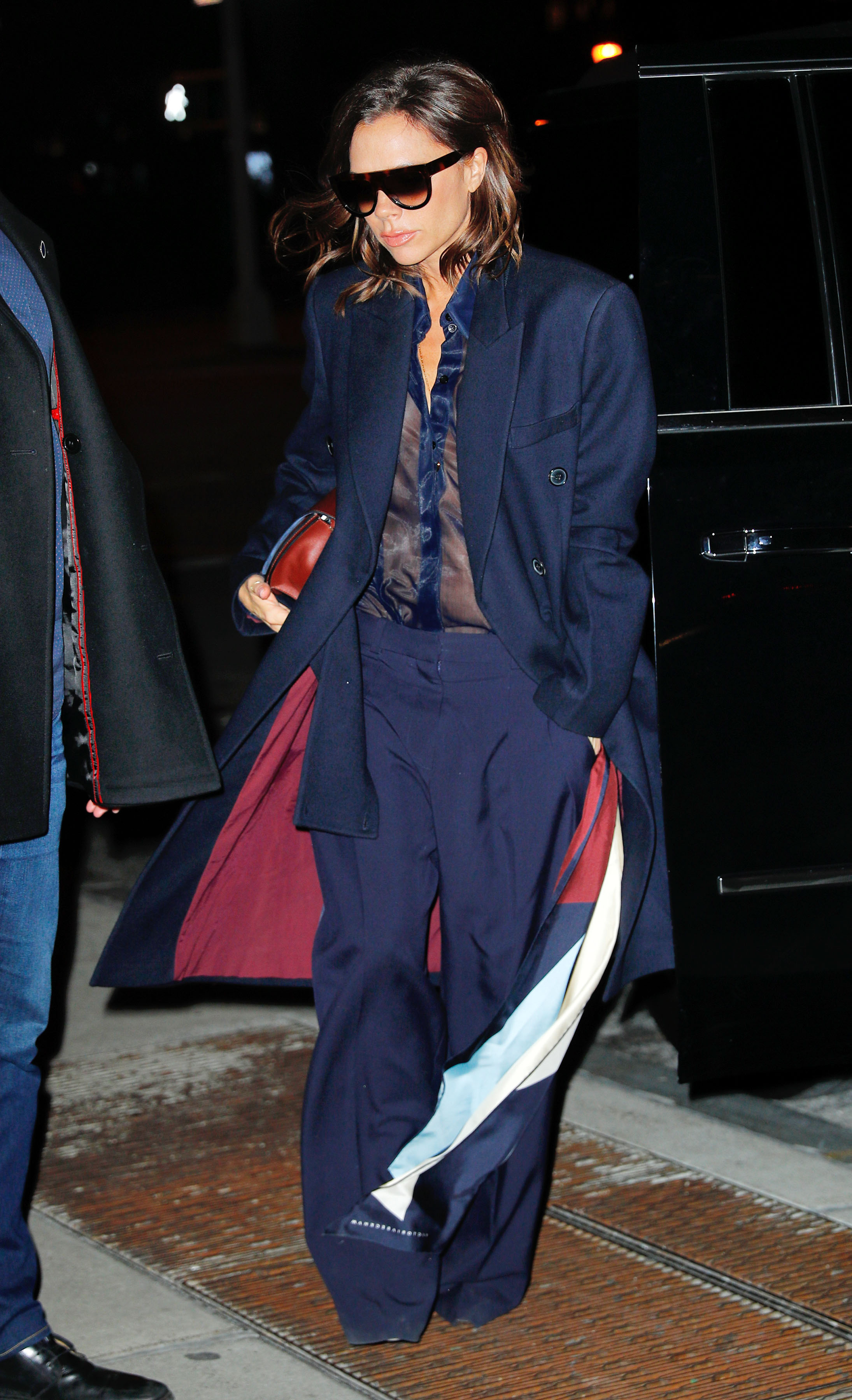 Victoria Beckham wears a chic navy outfit as she arrives outside her hotel in New York City, New York. <P> Pictured: Victoria Beckham <B>Ref: SPL1461587  140317  </B><BR/> Picture by: Jackson Lee / Splash News<BR/> </P><P> <B>Splash News and Pictures</B><BR/> Los Angeles:310-821-2666<BR/> New York:212-619-2666<BR/> London:870-934-2666<BR/> <span id=