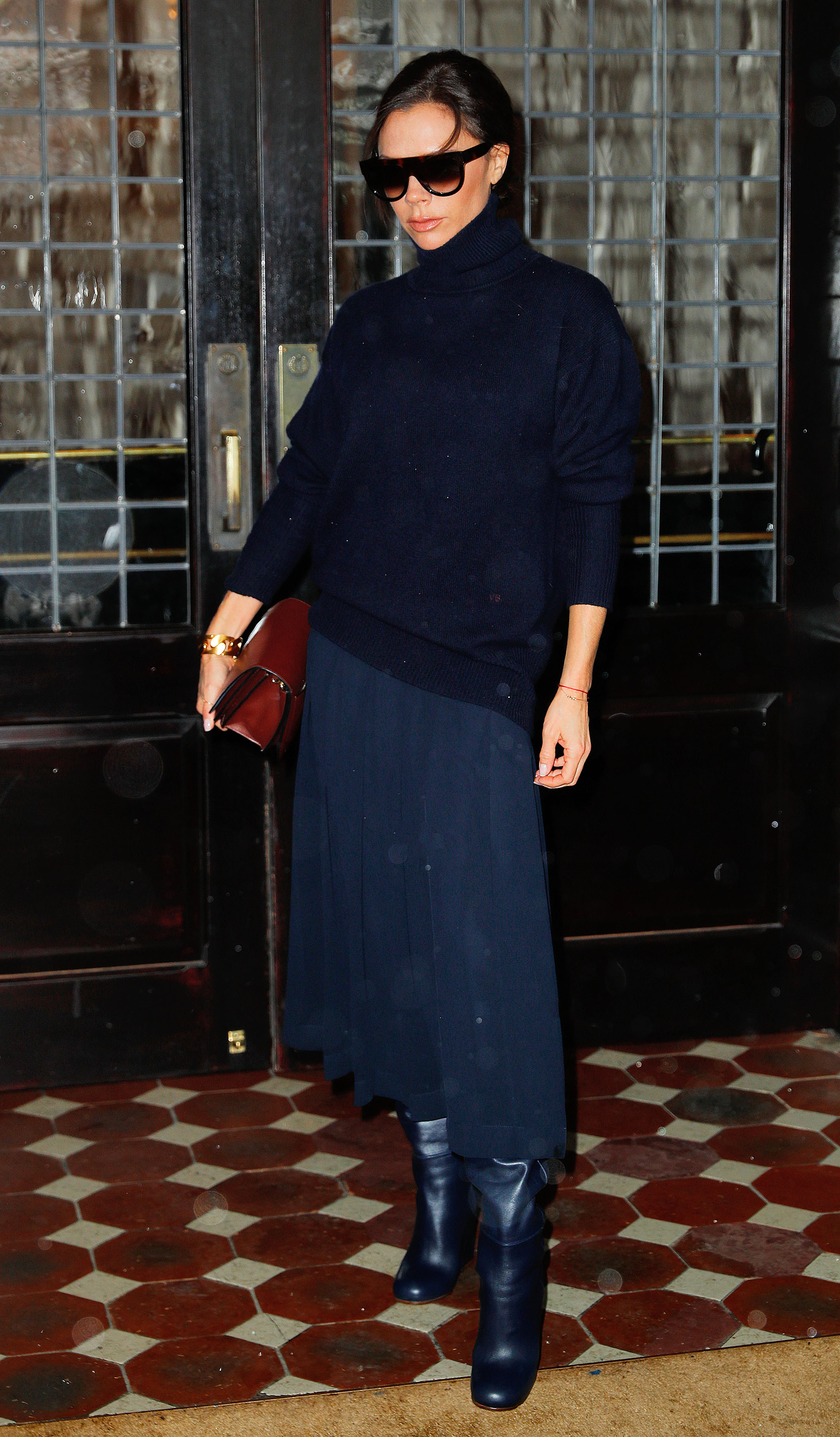 Victoria Beckham strikes a pose in another navy outfit when out in New York <P> Pictured: Victoria Beckham <B>Ref: SPL1461950  140317  </B><BR/> Picture by: Jackson Lee / Splash News<BR/> </P><P> <B>Splash News and Pictures</B><BR/> Los Angeles:310-821-2666<BR/> New York:212-619-2666<BR/> London:870-934-2666<BR/> <span id=